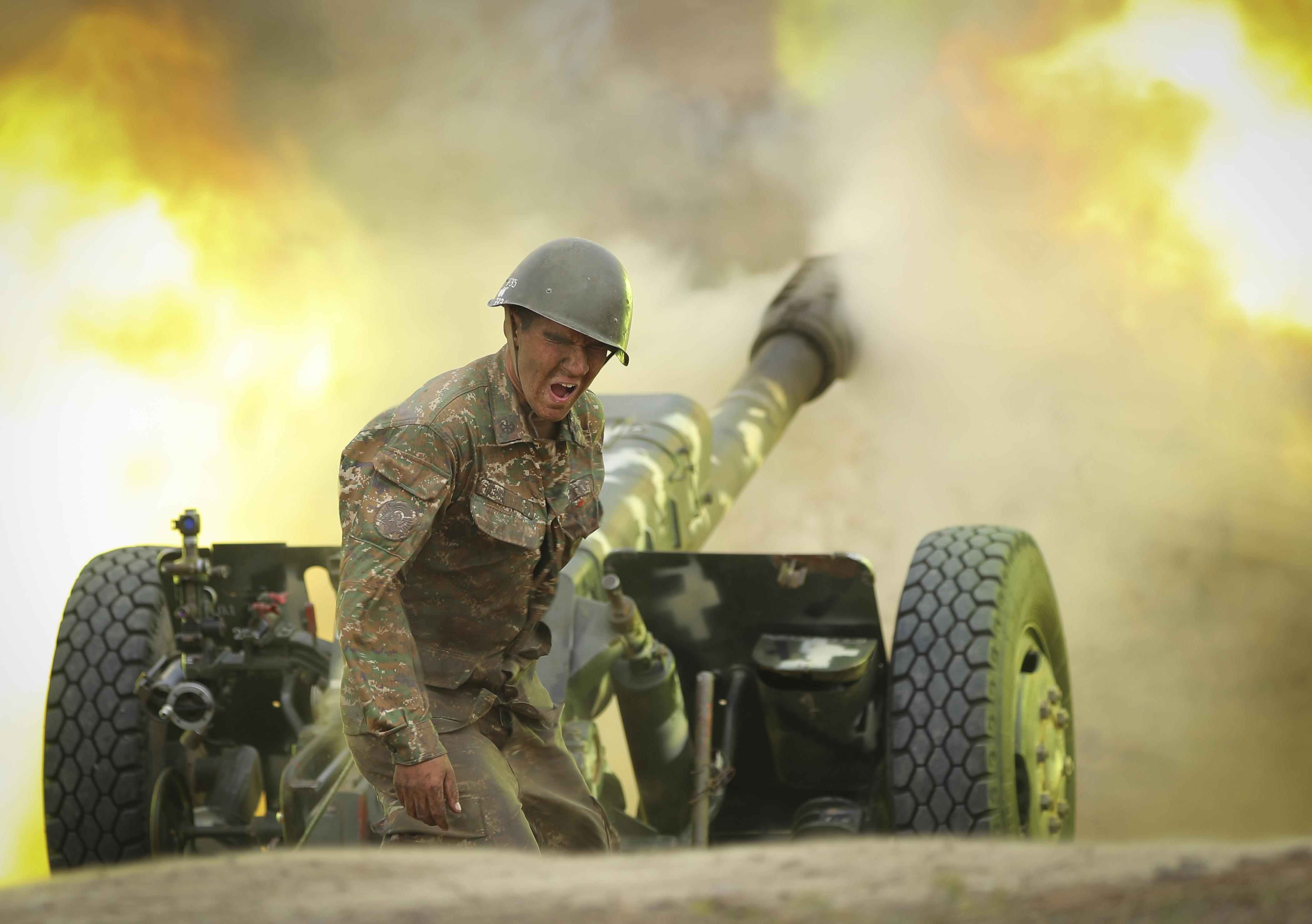 An Armenian serviceman fires a cannon towards Azerbaijan positions in the self-proclaimed Republic of Nagorno-Karabakh, Azerbaijan, Tuesday, Sept. 29, 2020.