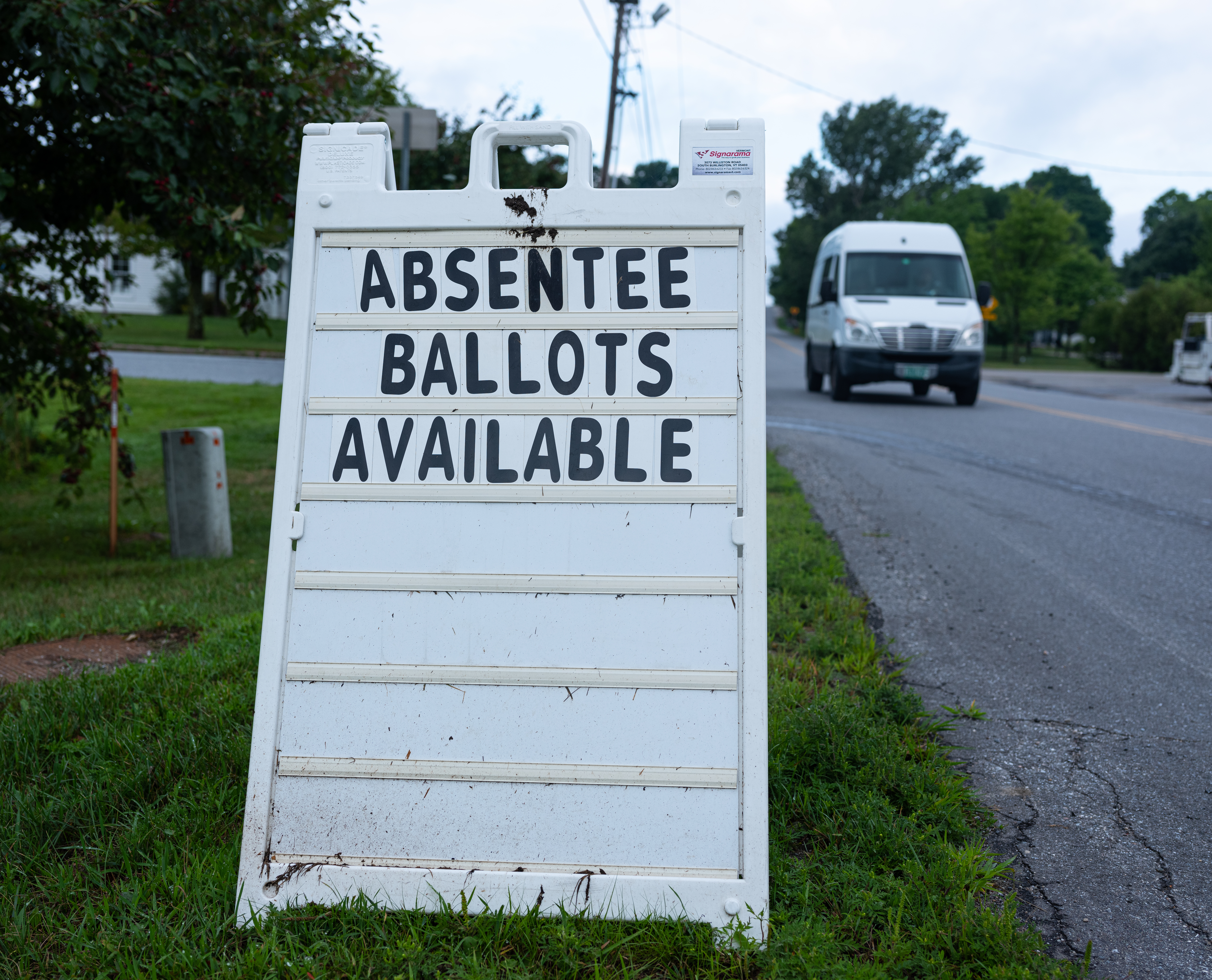 A street sign announces availability of absent ballots for the Vermont primary voting outside of the Town Hall on Aug. 10, 2020 in Charlotte, Vermont. Most states do not have accessible absentee ballot systems.
