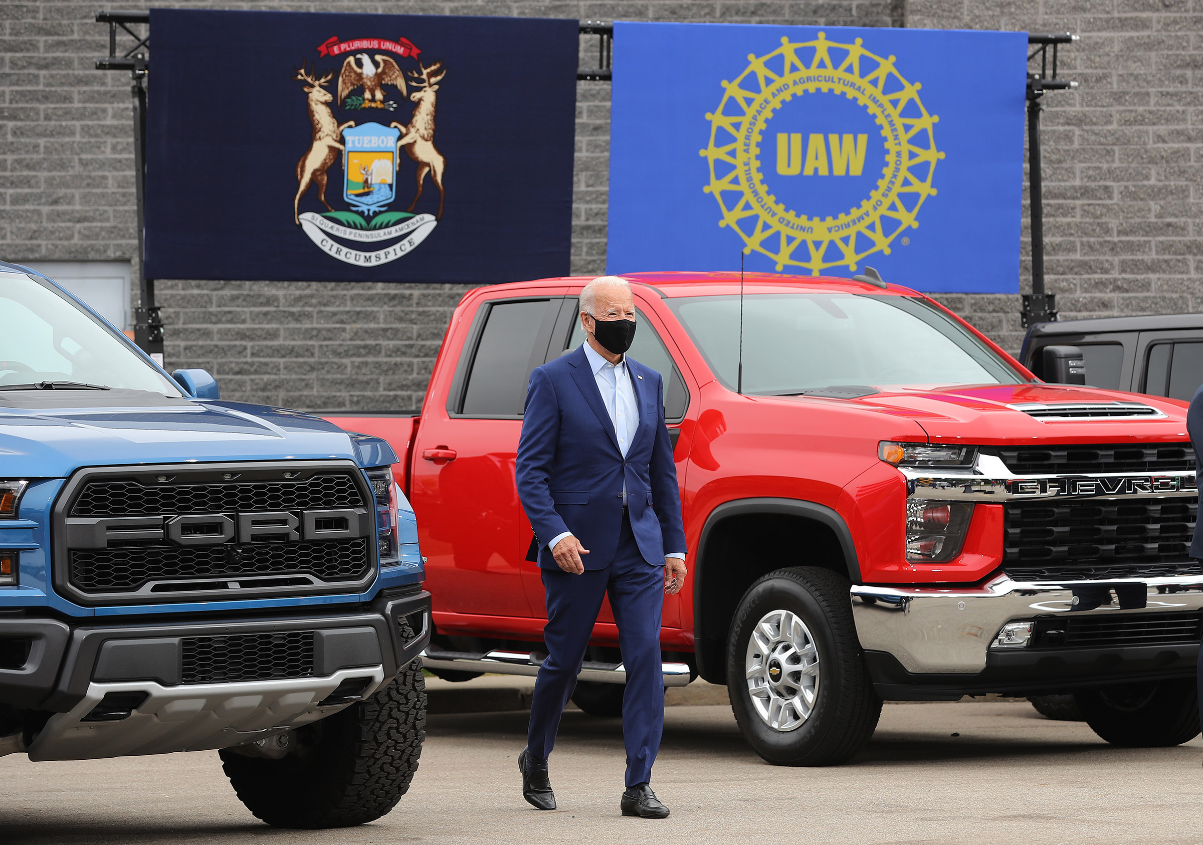 Democratic presidential nominee and former Vice President Joe Biden walks out in between pickup trucks before delivering remarks in the parking lot outside the United Auto Workers Region 1 offices in Warren, Mich., on Sept. 09, 2020.