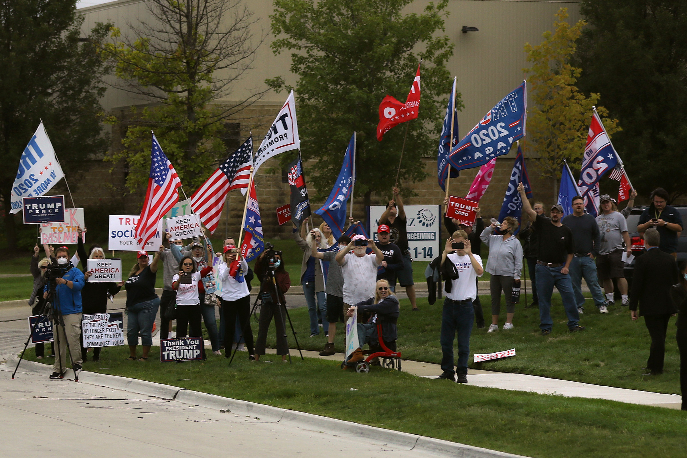 Supporters of President Donald Trump gather across the street from the United Auto Workers Region 1 offices where Democratic presidential nominee and former Vice President Joe Biden is scheduled to speak in Warren, Mich., on Sept. 09, 2020.