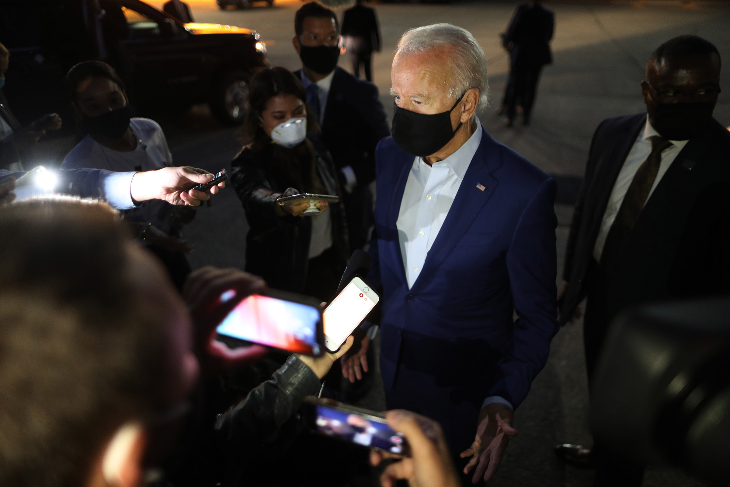 Democratic presidential nominee Joe Biden talks with journalists before departing the Detroit Metro area in Romulus, Mich., on Sept. 09, 2020. Biden was campaigning in Michigan, which President Donald Trump won in 2016 by less than 11,000 votes, the narrowest margin of victory in state's presidential election history.