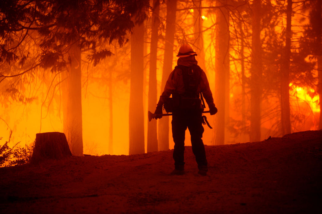 A firefighter fights against the Creek Fire which started Friday afternoon, blew up and grew to 73,278 acres on September 06, 2020, in Shaver Lake, Fresno County, California, United States.