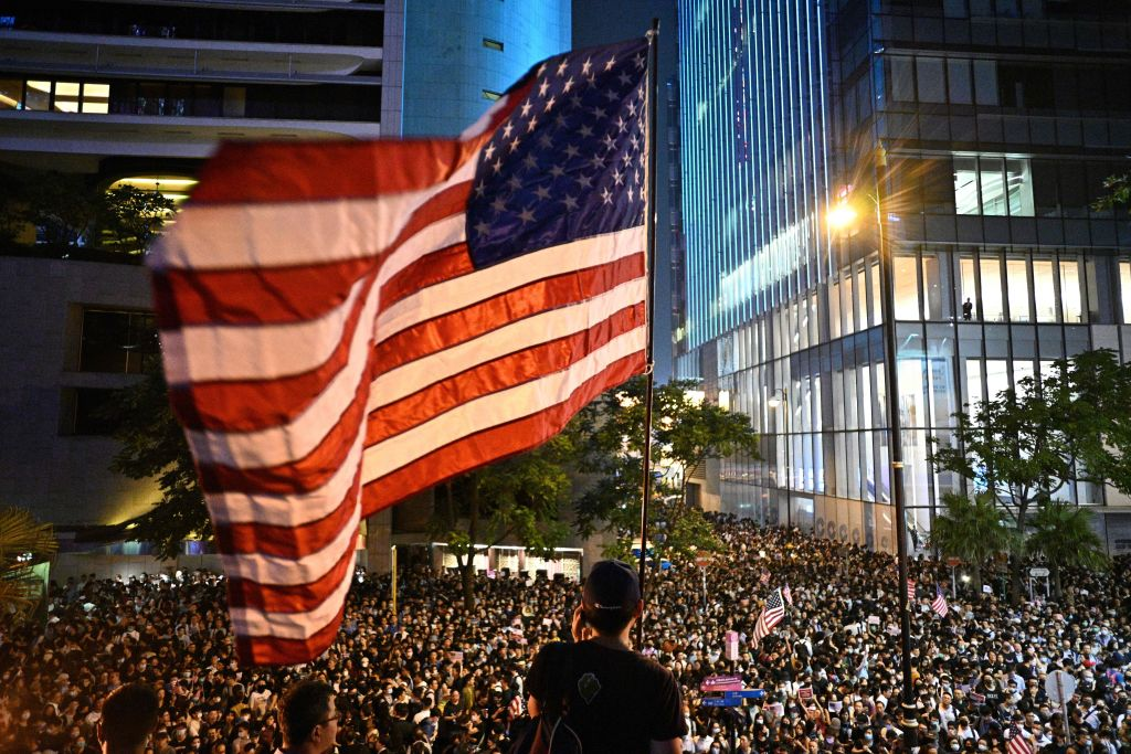 A man waves a US national flag as protesters attend a rally in Hong Kong on October 14, 2019.