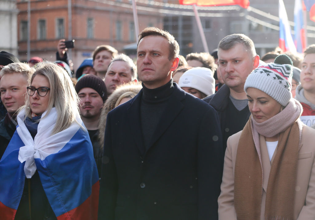 Navalny, center, and his wife Yulia, right, walk with demonstrators during a rally in Moscow in February 2019.
