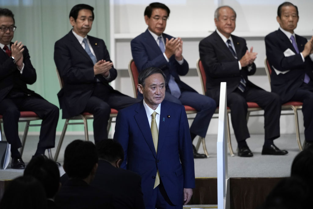 Yoshihide Suga, Japan's chief cabinet secretary, acknowledges the audience after winning the Liberal Democratic Party's (LDP) leadership election in Tokyo, Japan, on Monday, Sept. 14, 2020.