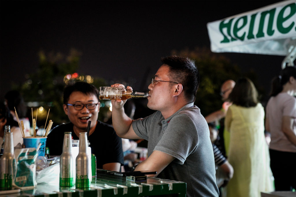 Residents drink during the Wuhan Beer Festival on August 21, 2020 in Wuhan, Hubei, China.