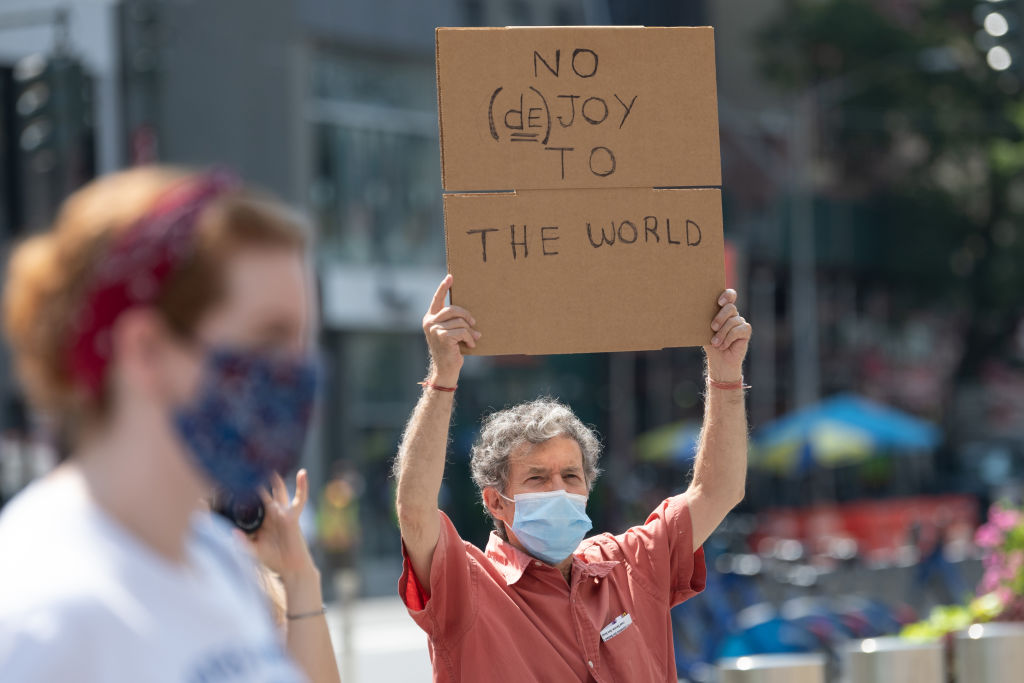 A man at the  Save The Post Office  rally outside a post office building on August 25, 2020 in New York City.