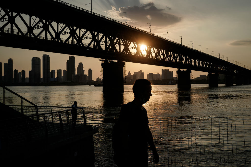 A man walks next to the Yangtze River on September 2, 2020 in Wuhan, Hubei province, China.