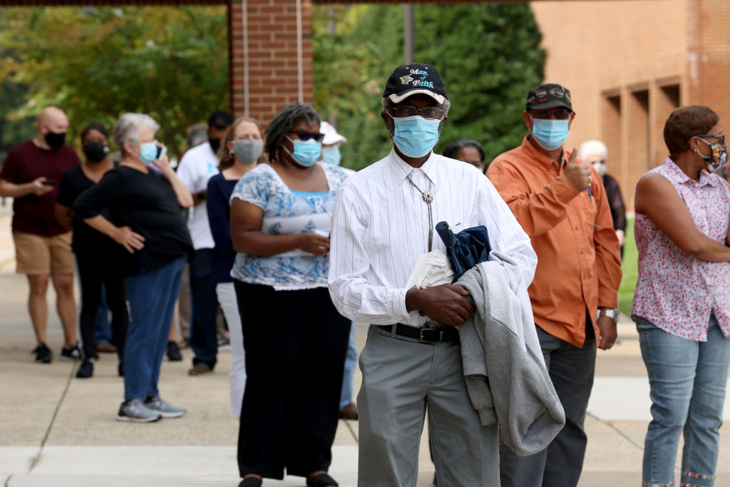 Voters in Virginia's 7th district wait in line to vote at the Henrico County Registrar's office in Henrico, Virginia, on September 18, 2020.