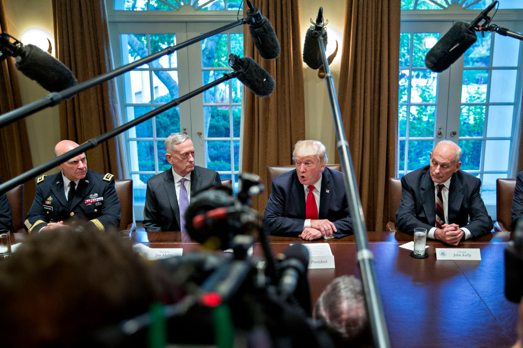 U.S. President Donald Trump (C), then national security advisor H.R. McMaster (L), Defense Secretary Jim Mattis  (2nd L) and then White House chief of staff John Kelly (R) attend a briefing with senior military leaders in the Cabinet Room of the White House in Washington, D.C., on October 5, 2017.