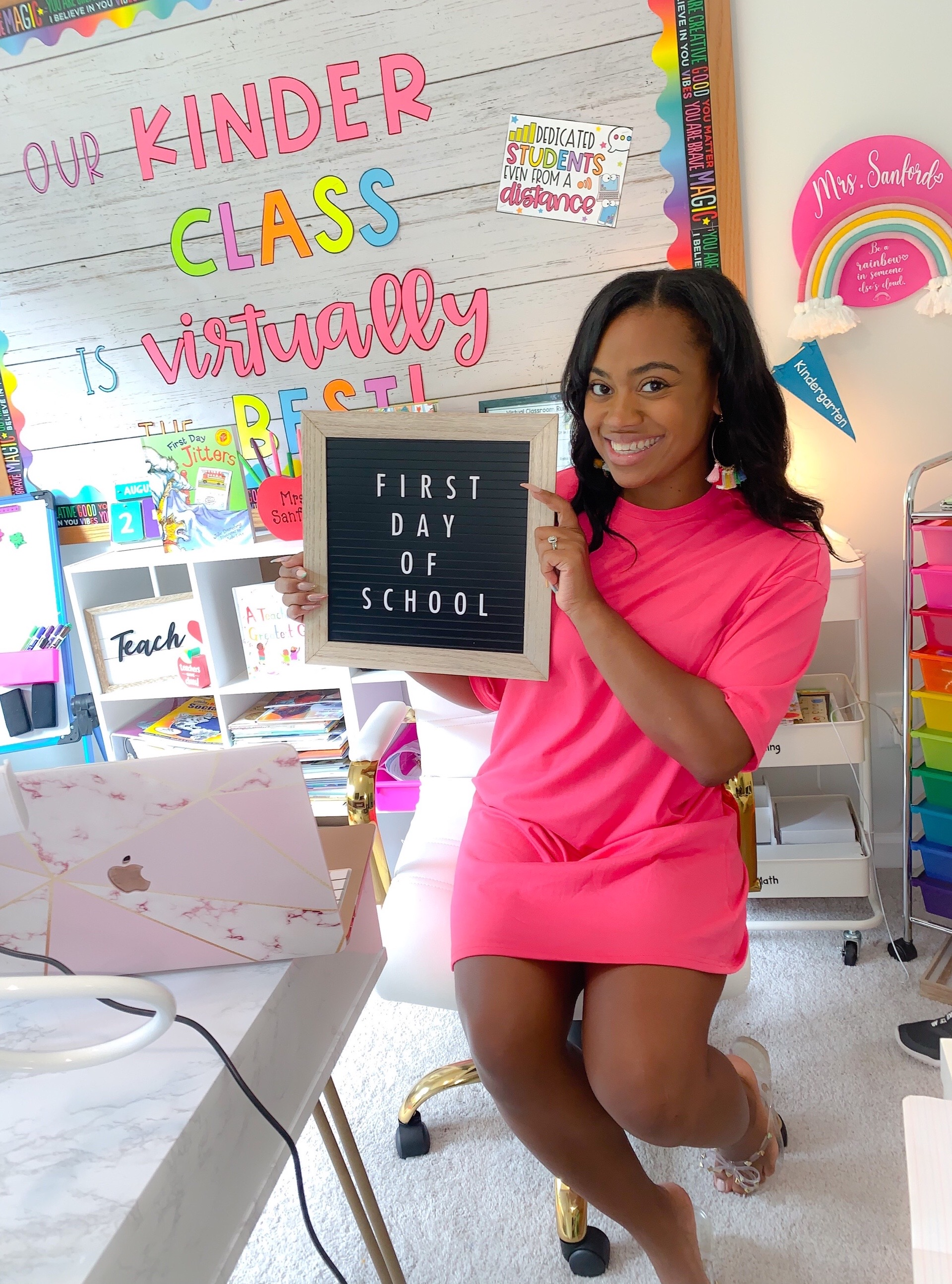 Traneisha Sanford, a kindergarten teacher in Georgia, sits at her desk in her home on the first day of school.