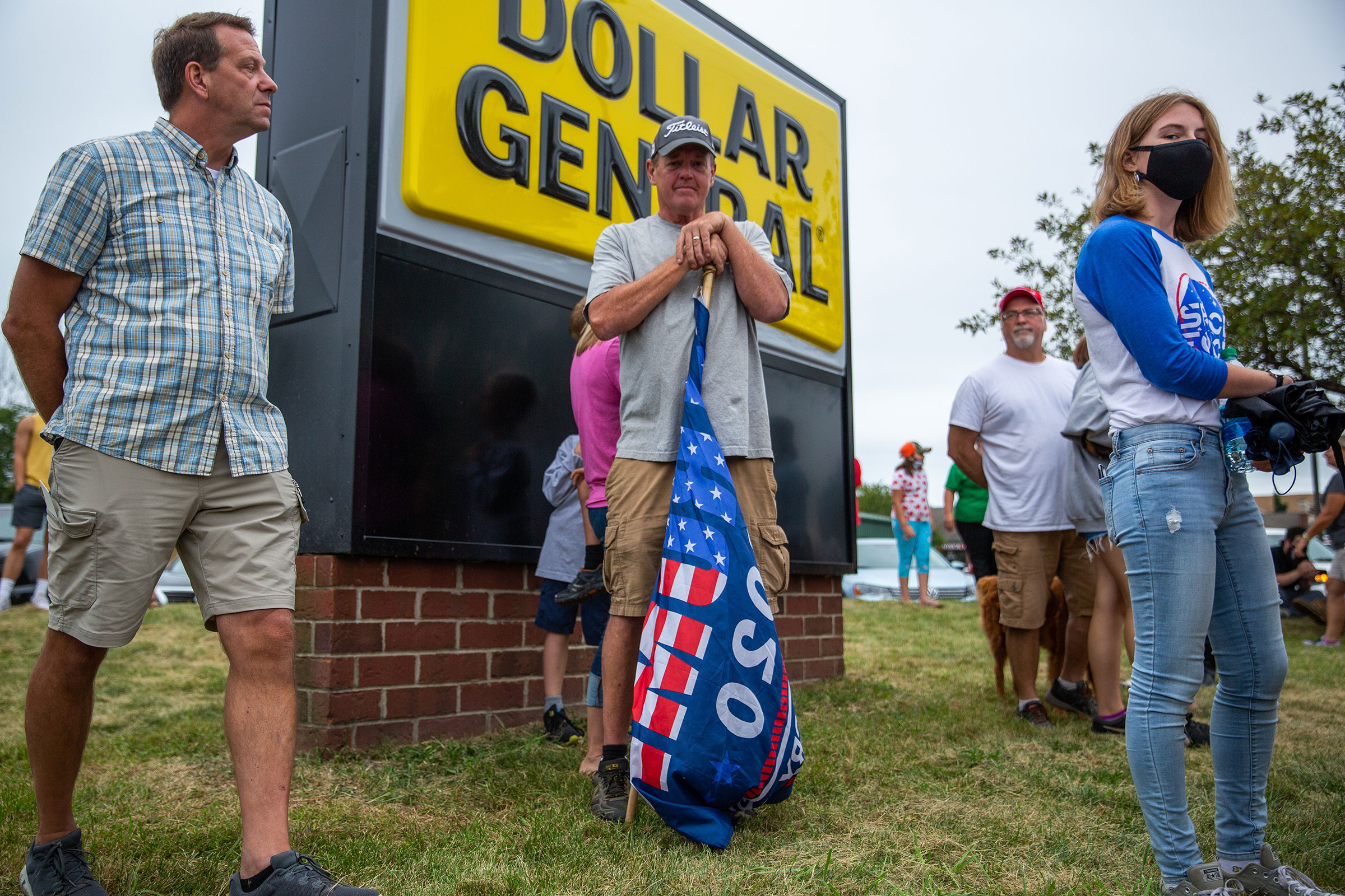 A supporter of President Donald Trump waits to see the President's motorcade in Kenosha, Wis., on Sept. 1, 2020.