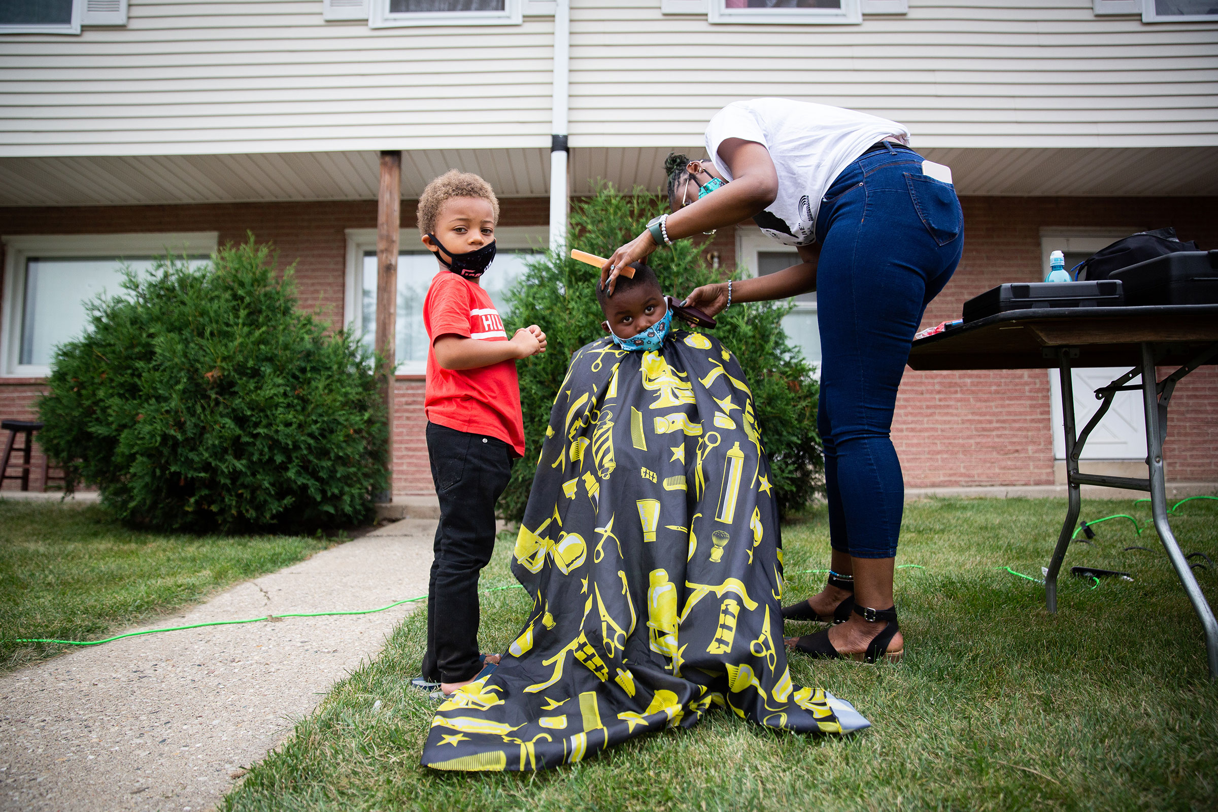 A young boy gets his haircut at the community gathering hosted by Jacob Blake's family in Kenosha, Wis., on Sept. 1, 2020.