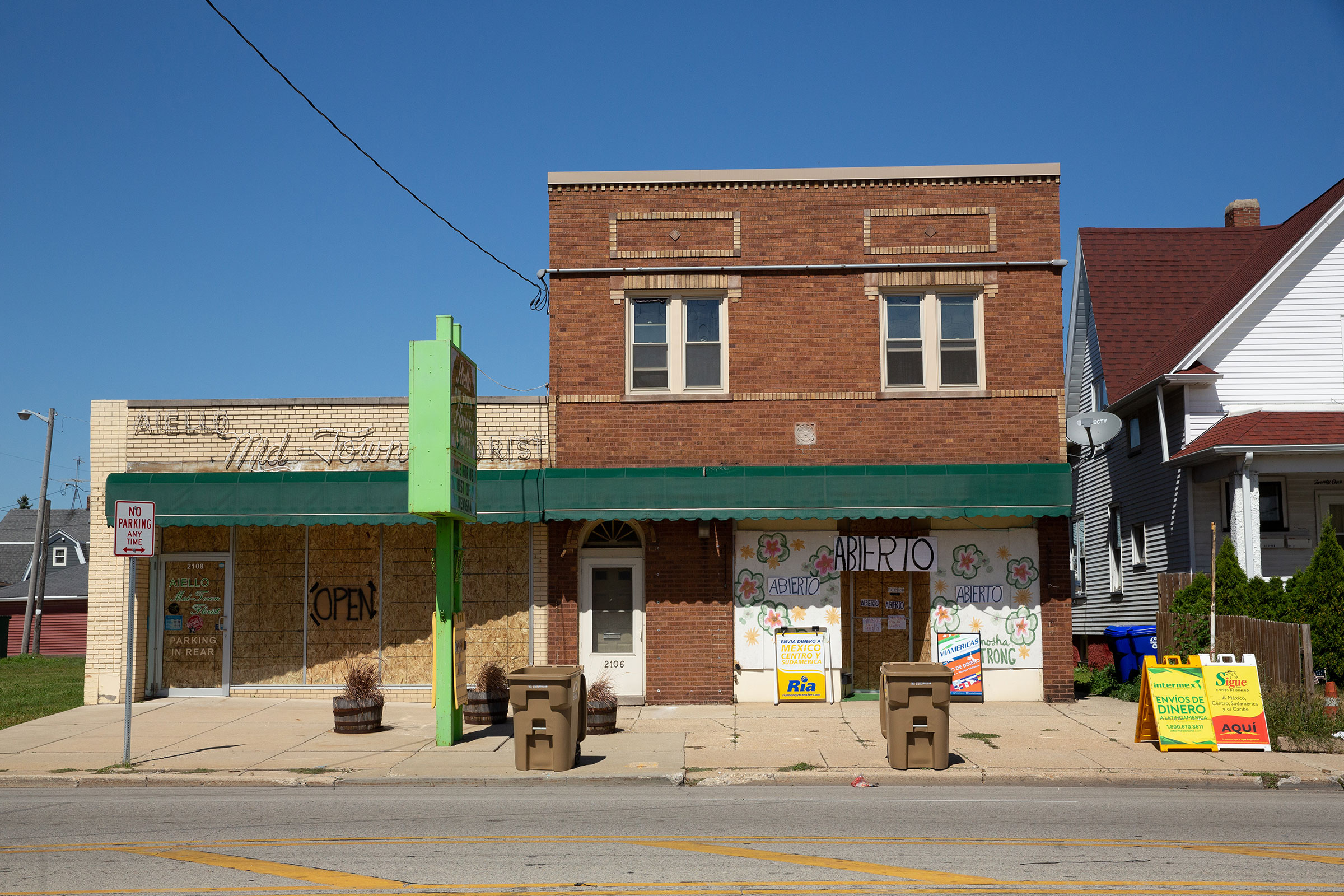 Boarded-up windows on businesses let patrons know they are still open in Kenosha, Wis., on Sept. 2, 2020.