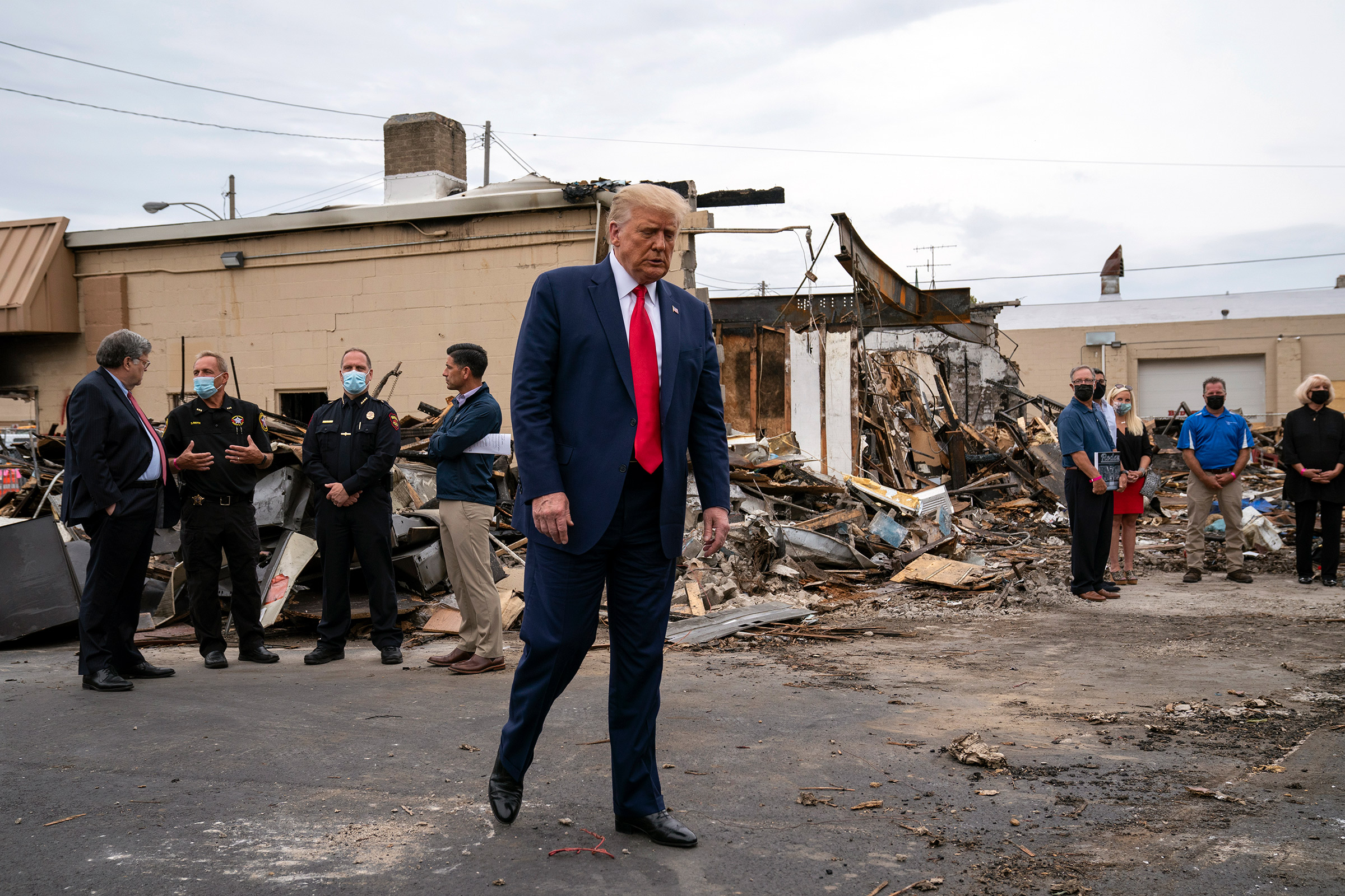 President Donald Trump tours an area Tuesday that was damaged during demonstrations after a police officer shot Jacob Blake in Kenosha, Wis., on Sept. 1, 2020.