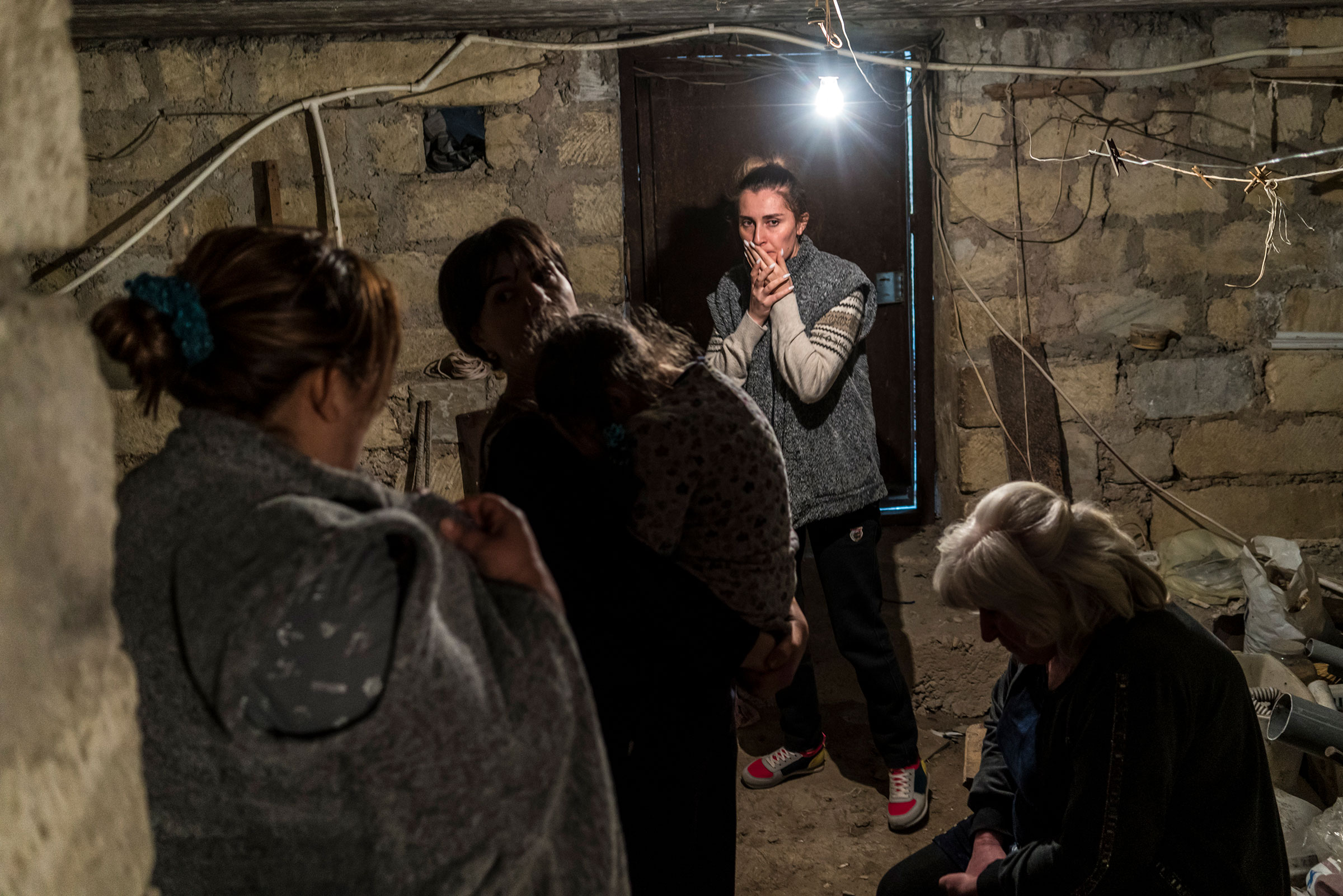 Residents shelter in a basement as air raid sirens sound on Sept. 29, 2020 in Stepanakert, Nagorno-Karabakh.