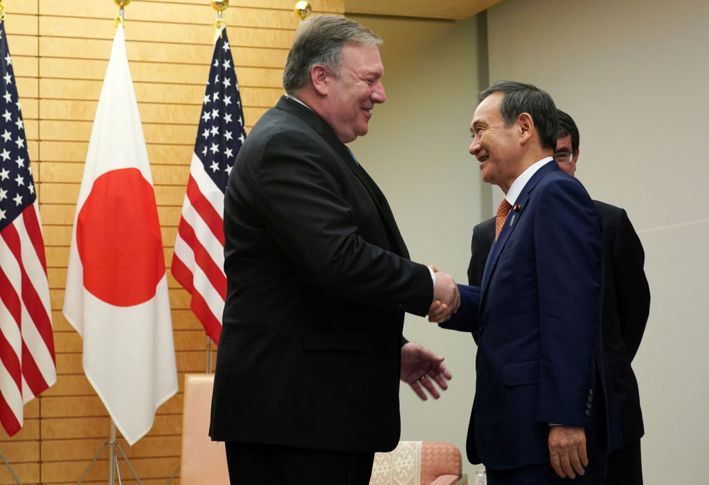 Secretary of State Mike Pompeo (L) speaks to Japan's then-Chief Cabinet Secretary Yoshihide Suga at the prime minister's office in Tokyo on Oct. 6, 2018.