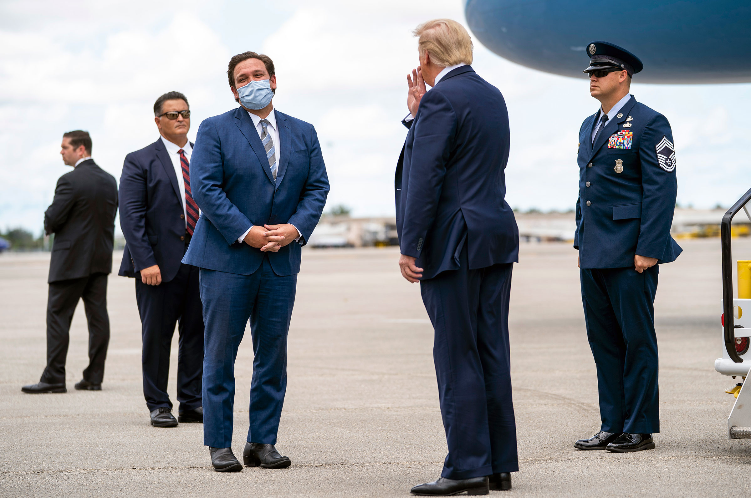 President Donald Trump is greeted by Gov. Ron DeSantis of Florida upon his arrival at Palm Beach International Airport on Sept. 8, 2020.