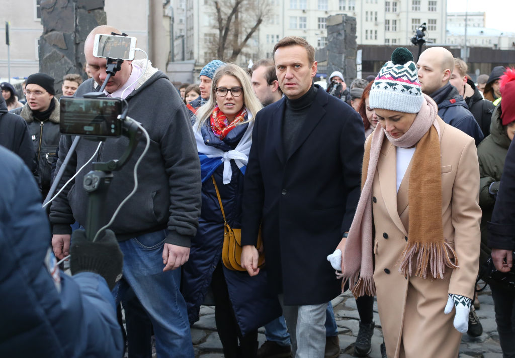 Alexey Navalny, Russian opposition leader, second right, and his wife Yulia, right, walk with demonstrators during a rally in Moscow, Russia, on Saturday, Feb. 29, 2019.