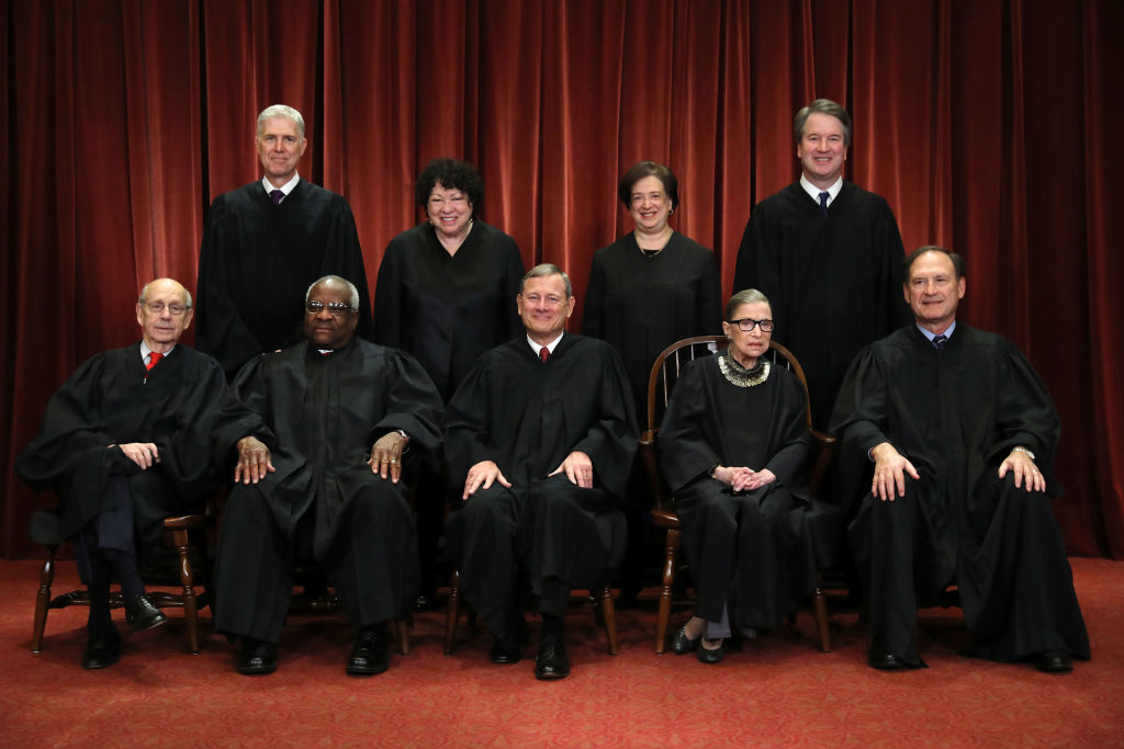 United States Supreme Court (Front L-R) Associate Justice Stephen Breyer, Associate Justice Clarence Thomas, Chief Justice John Roberts, Associate Justice Ruth Bader Ginsburg, Associate Justice Samuel Alito, Jr., (Back L-R) Associate Justice Neil Gorsuch, Associate Justice Sonia Sotomayor, Associate Justice Elena Kagan and Associate Justice Brett Kavanaugh pose for their official portrait at the in the East Conference Room at the Supreme Court building Nov. 30, 2018 in Washington, DC.