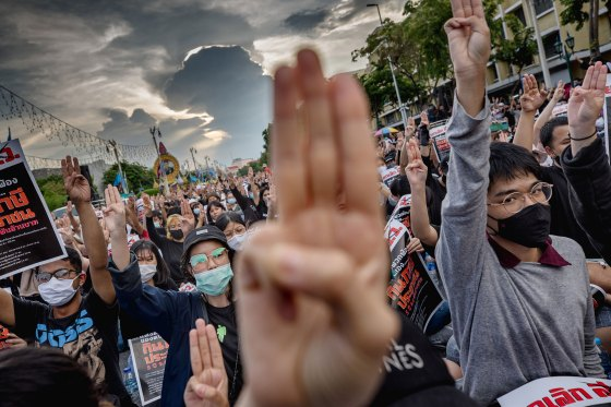 Protesters perform a 'Hunger Games' three finger salute during anti-government demonstration in Bangkok