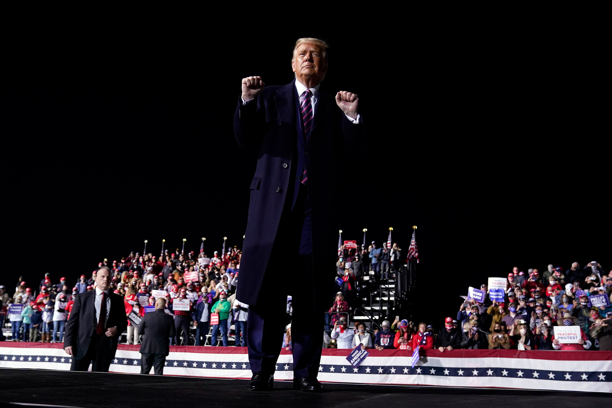 President Donald Trump gestures to the crowd as he finishes speaking at a campaign rally at Bemidji Regional Airport, Friday, Sept. 18, 2020, in Bemidji, Minn. (AP Photo/