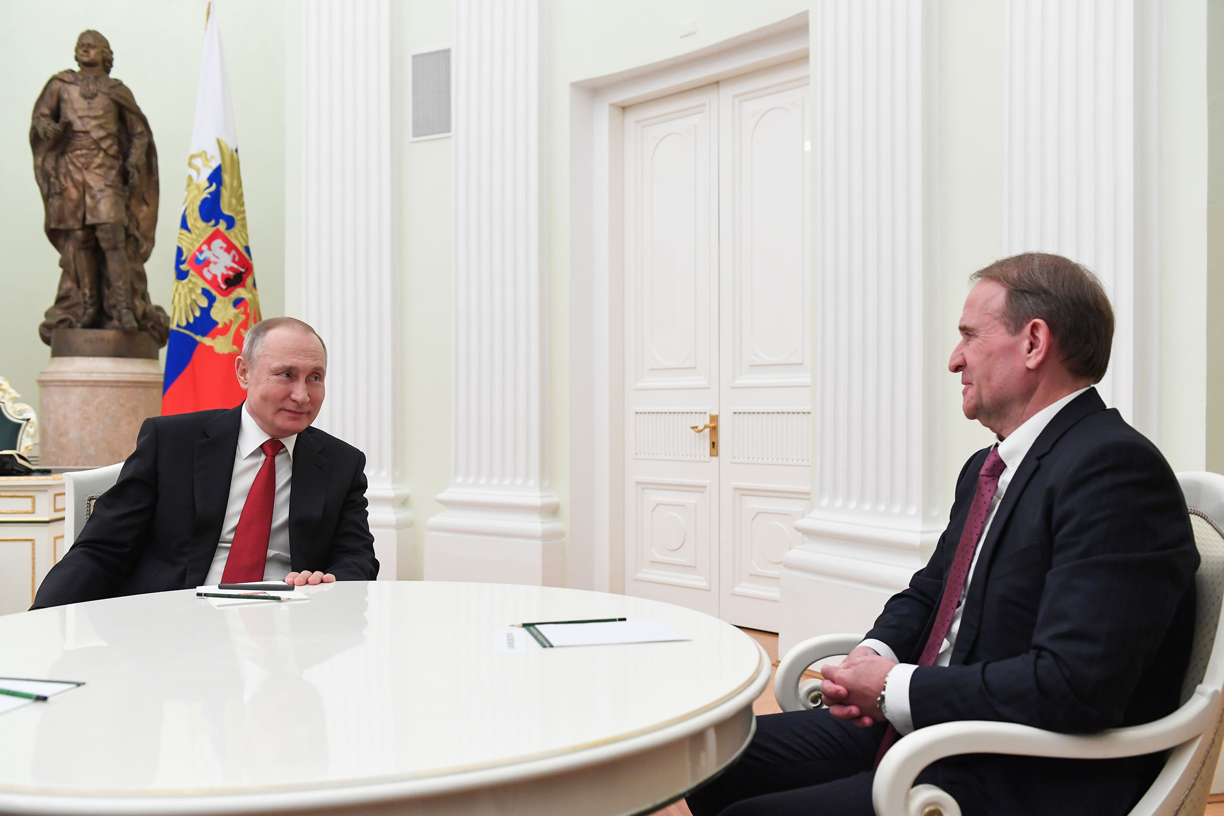 Russian President Vladimir Putin and Viktor Medvedchuk, Chairman of Ukraine's Opposition Platform during a meeting at the Moscow Kremlin.