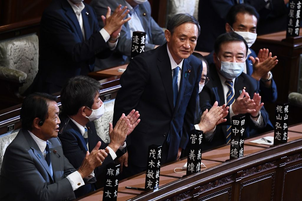 Newly elected leader of Japan's Liberal Democratic Party (LDP) Yoshihide Suga is applauded after he was elected as Japan's prime minister by the Lower House of parliament in Tokyo on Sept. 16, 2020.
