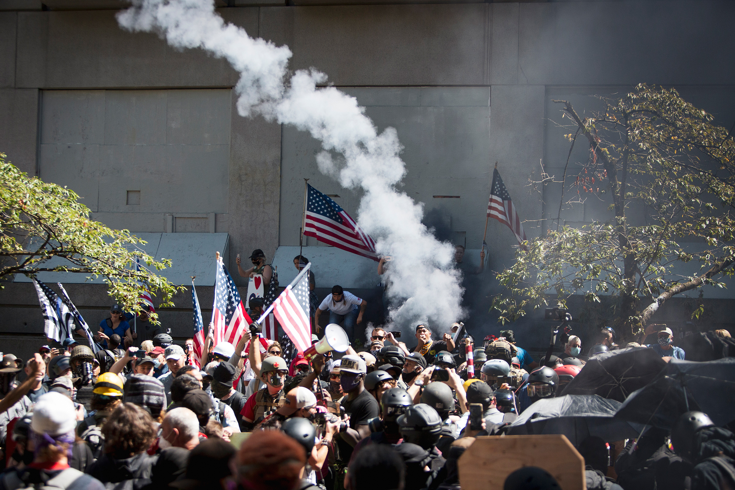 Far-right protesters clash with left-wing counter­protesters at the Justice Center in Portland, Ore., on Aug. 22
