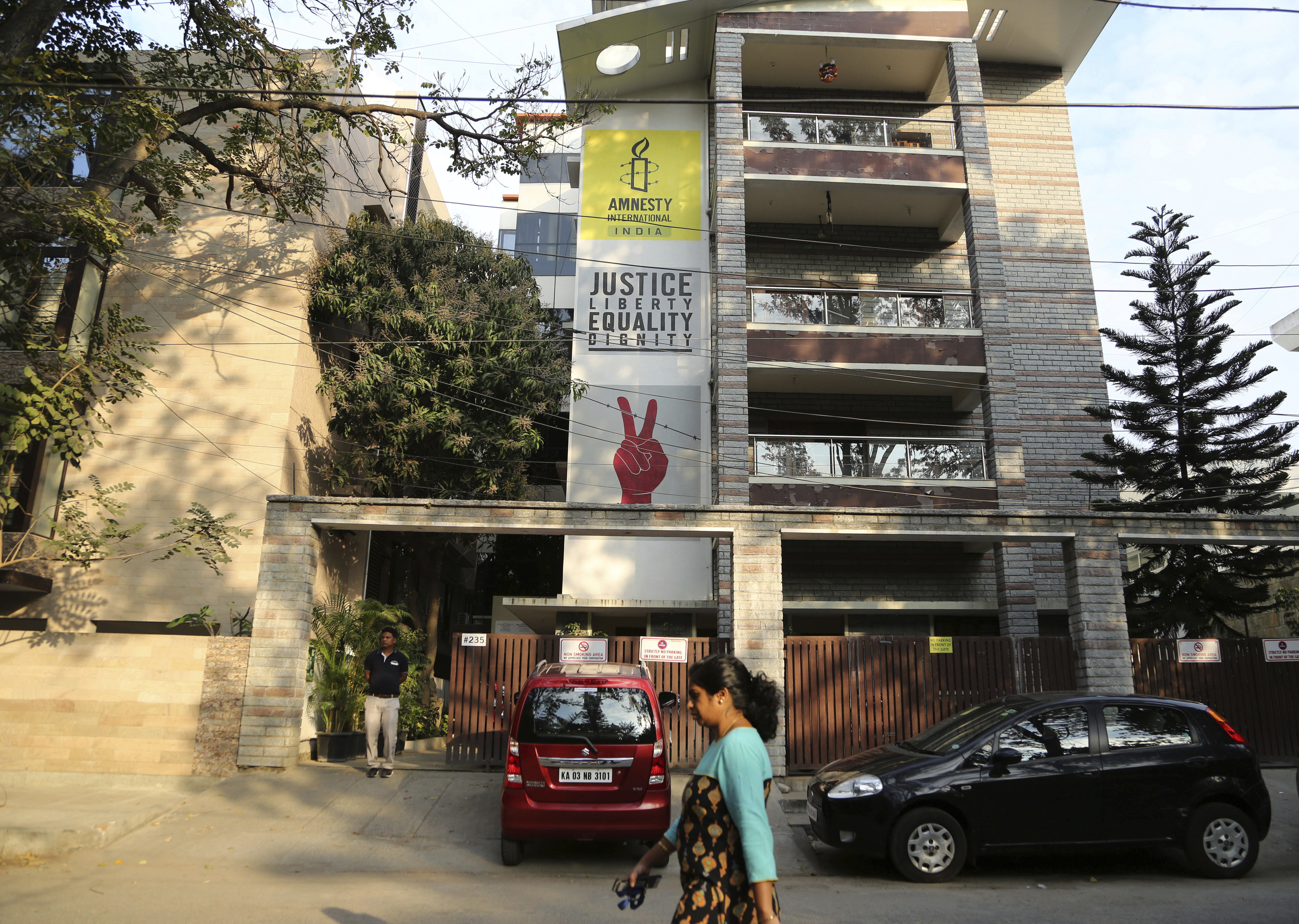 A woman walks past the Amnesty International India headquarters in Bangalore, India on  Feb. 5, 2019.