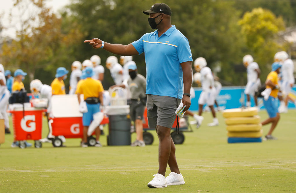 Head Coach Anthony Lynn works with players of the Los Angeles Chargers football team during practice at the Hammett Sports Complex in Costa Mesa on Monday Aug. 17, 2020 in preparation for the 2020 NFL season.  (Al Seib / Los Angeles Times