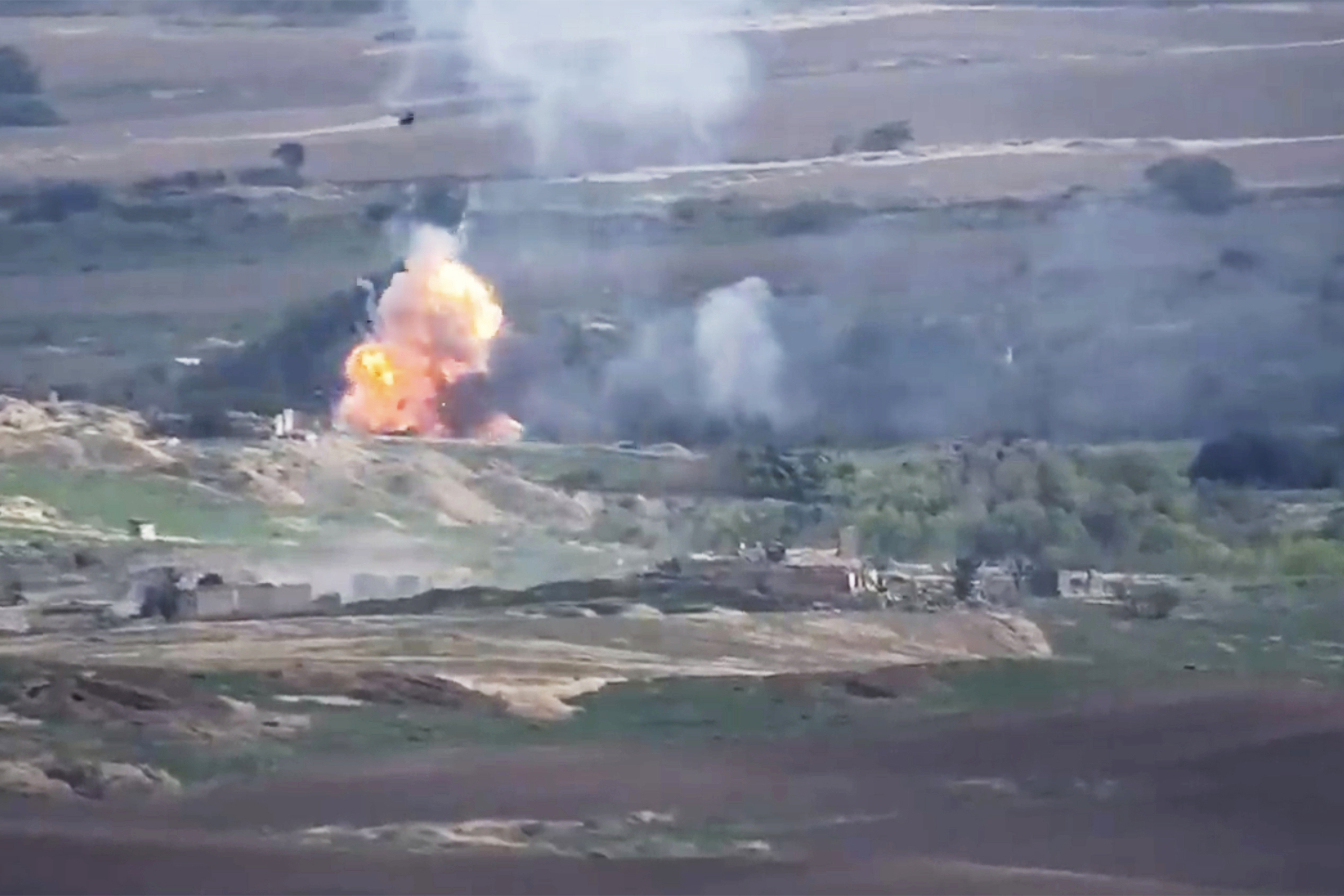This image taken from a video released by Armenian Defense Ministry on Sept. 28, 2020 allegedly shows fighting between Armenian and Azerbaijani forces at the contact line of the self-proclaimed Republic of Nagorno-Karabakh, Azerbaijan.