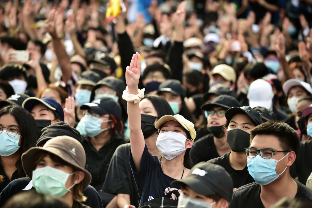 A protester holds up a three-finger salute at a rally in Bangkok on Aug. 16, 2020.