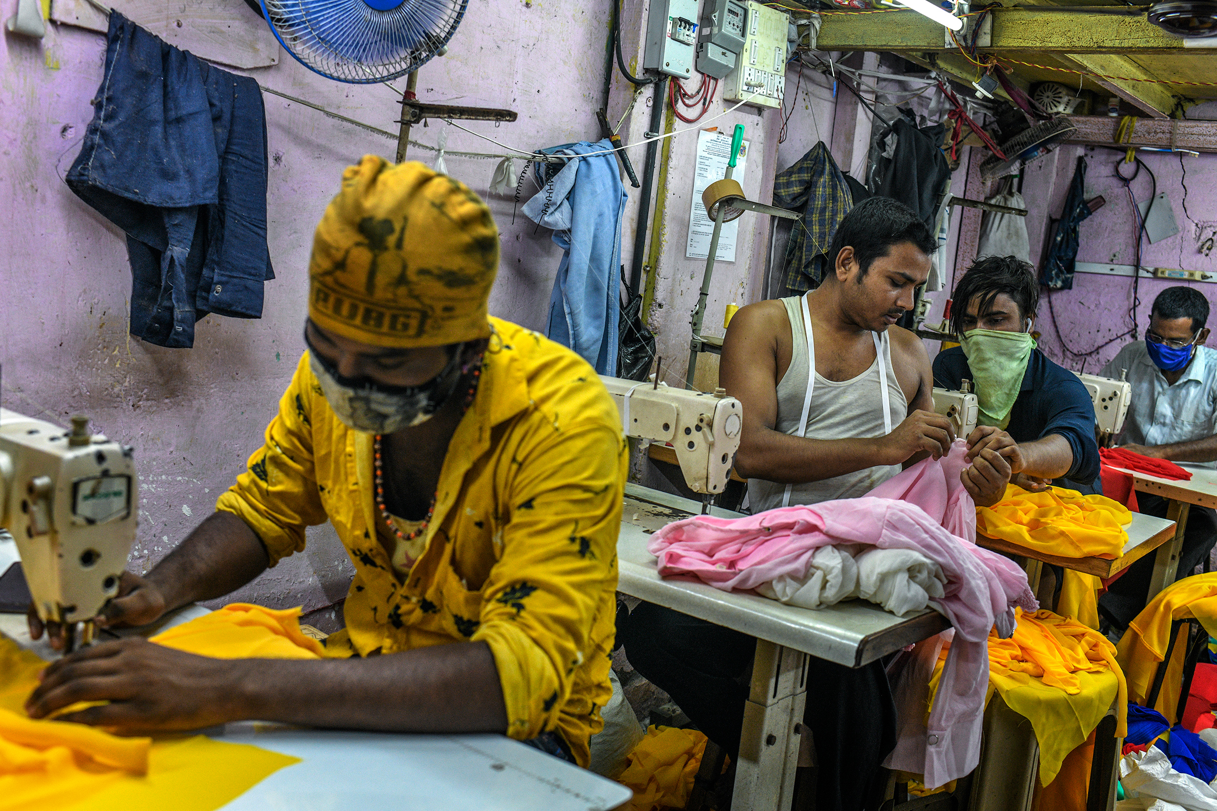 My family was worried about the disease and didn't want me to return to the city, but I had to come back to work,  said Ishrar Ali, who stitches women's tops in a garment workshop in Dharavi.