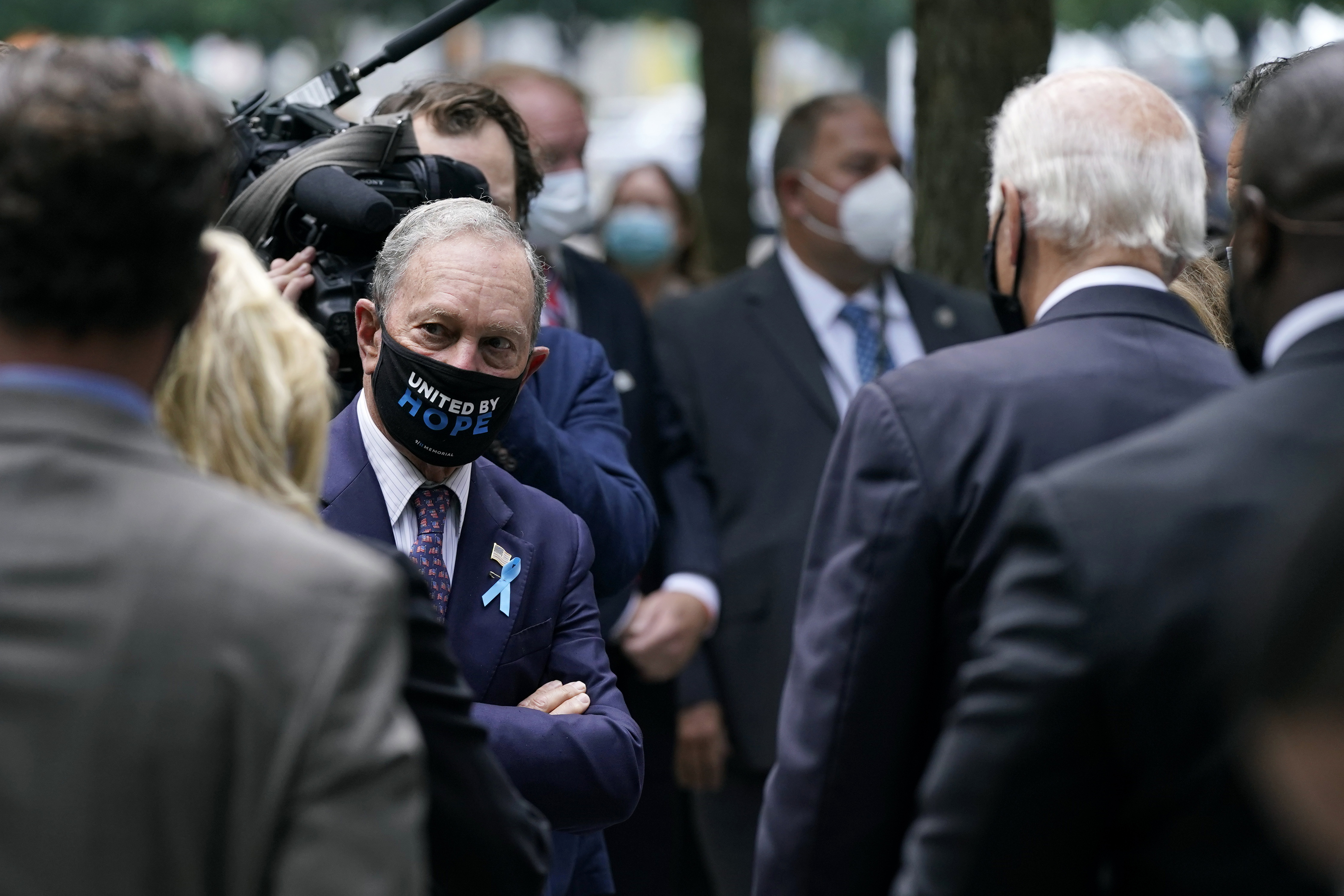 Former New York Mayor Michael Bloomberg, left, visits with Democratic presidential candidate and former Vice President Joe Biden at the National September 11 Memorial in New York, Sept. 11, 2020.