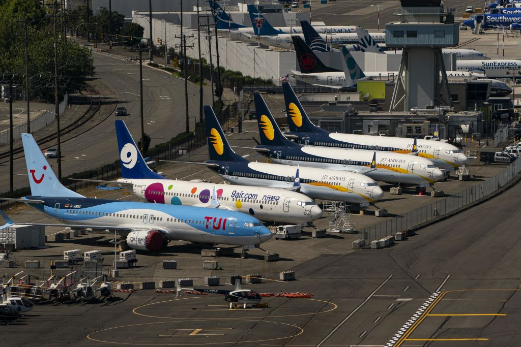 Boeing 737 Max airplanes sit parked at Boeing Field in Seattle, Washington, U.S., on Monday, July 27, 2020. Boeing is scheduled to release earnings figures on July 29.