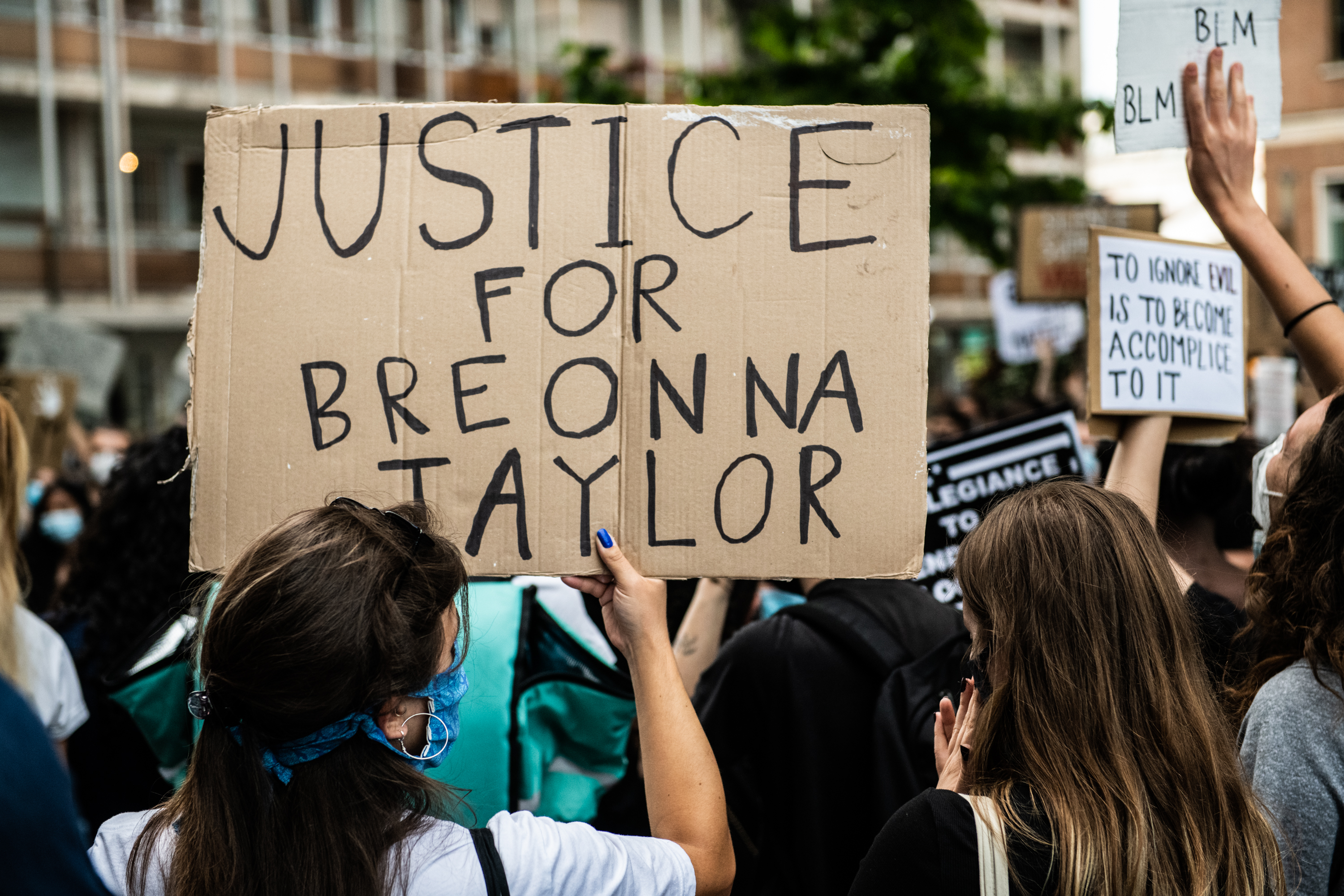 A girl holds a sign asking justice for Breonna Taylor while demonstrating in Venice, Italy on June 6, 2020.
