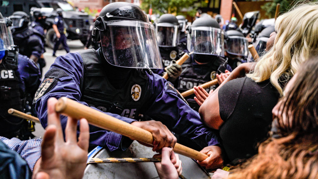 Riot police intervene in protests over the death of Breonna Taylor in Louisville, Kentucky, on Sept. 23, 2020.