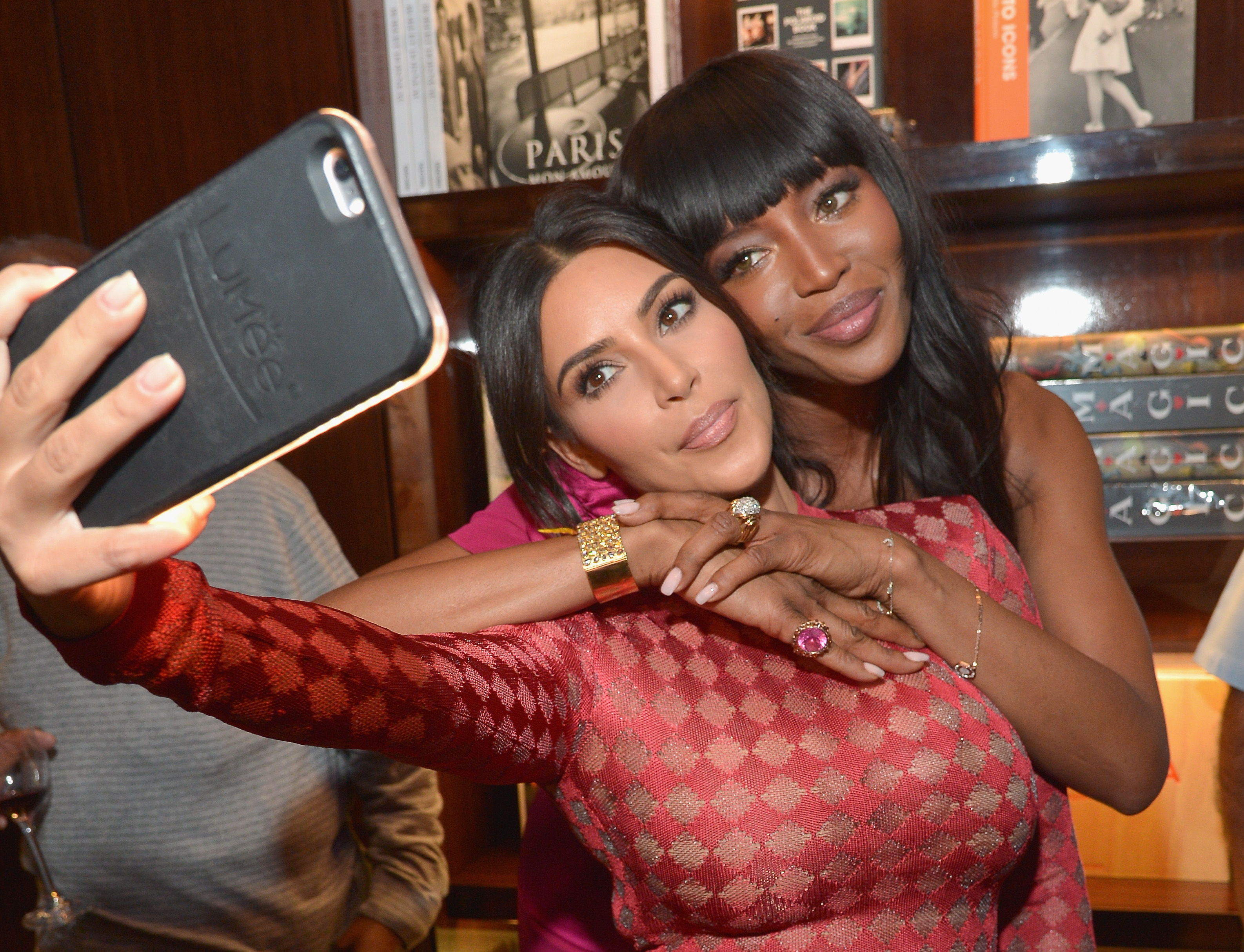 TV personality Kim Kardashian and model Naomi Campbell take a selfie in 2016.