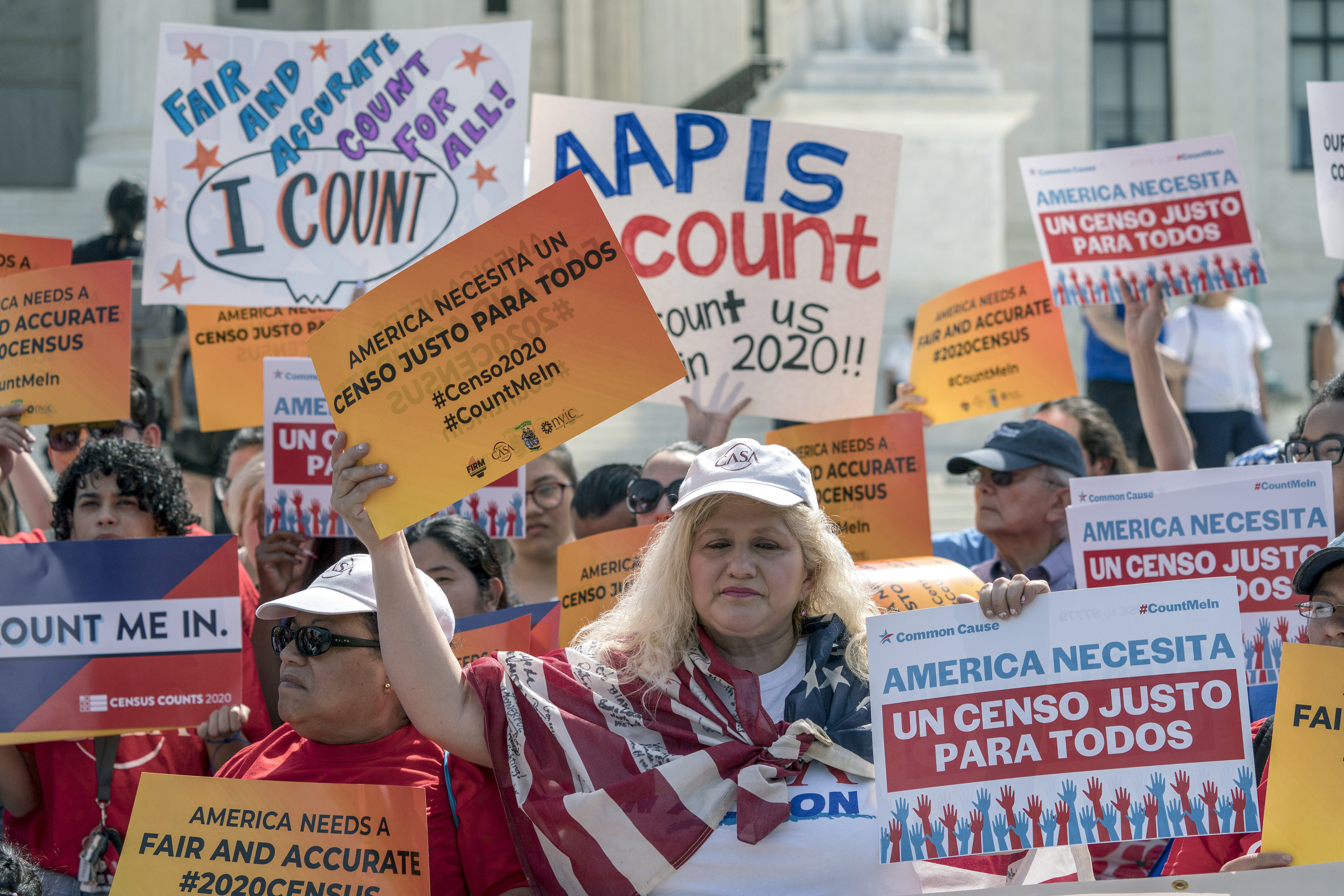 Immigration activists rally outside the Supreme Court as the justices hear arguments over the Trump administration's plan to ask about citizenship on the 2020 census, in Washington on April 23, 2019.