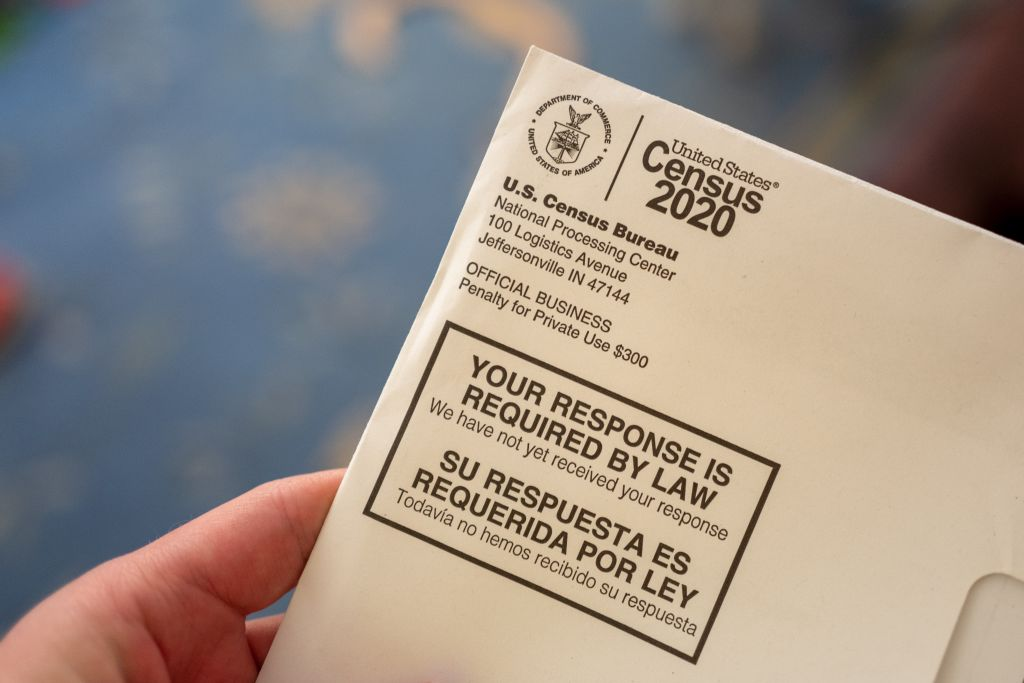 A hand holding a letter from the Census Bureau regarding the 2020 Census, San Ramon, Calif., April 24, 2020.