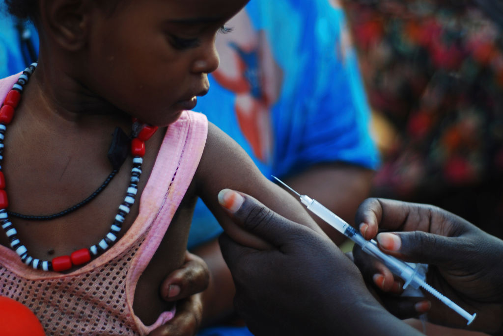 A nurse vaccinating a baby boy in Djibouti City, Djibouti.