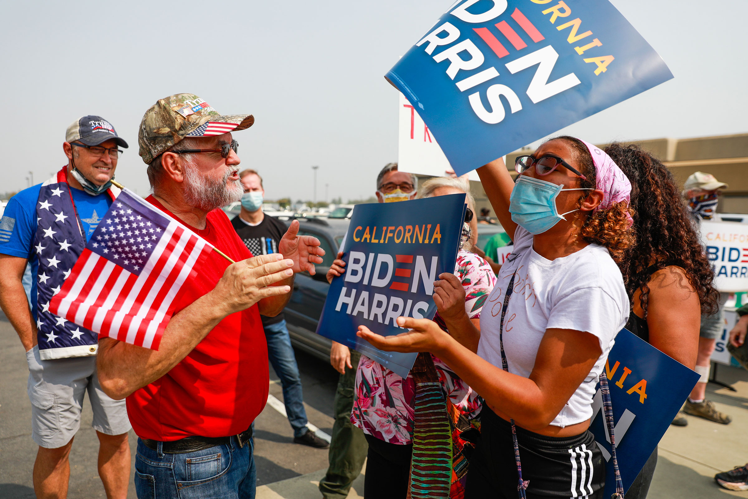 A Trump supporter argues with a Biden supporter on the street outside Sacramento McClellan Airport as President Donald Trump was being briefed on wildfires in a hangar in McClellan Park, Sacramento, Calif., on Sept. 14, 2020.