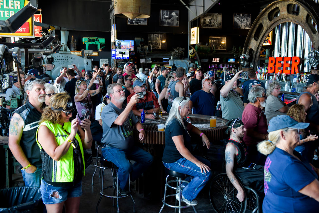 People watch a concert at the 80th Annual Sturgis Motorcycle Rally in Sturgis, South Dakota on Aug. 9, 2020. More than 200 coronavirus cases have been linked to the rally.