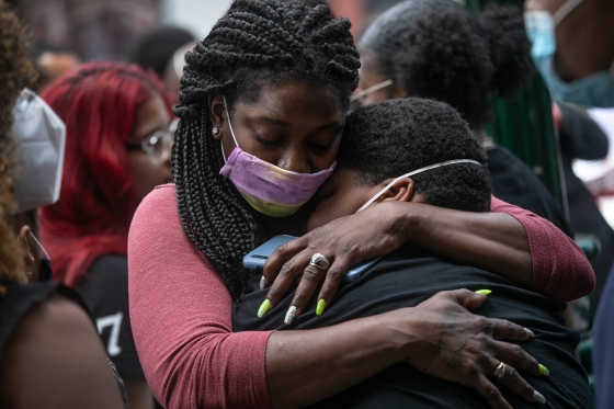 Friends and family mourn the death of Conrad Coleman Jr. on July3 in New Rochelle, N.Y. Coleman, 39, died of COVID-19 on June20, just over two months after his father also died of the disease