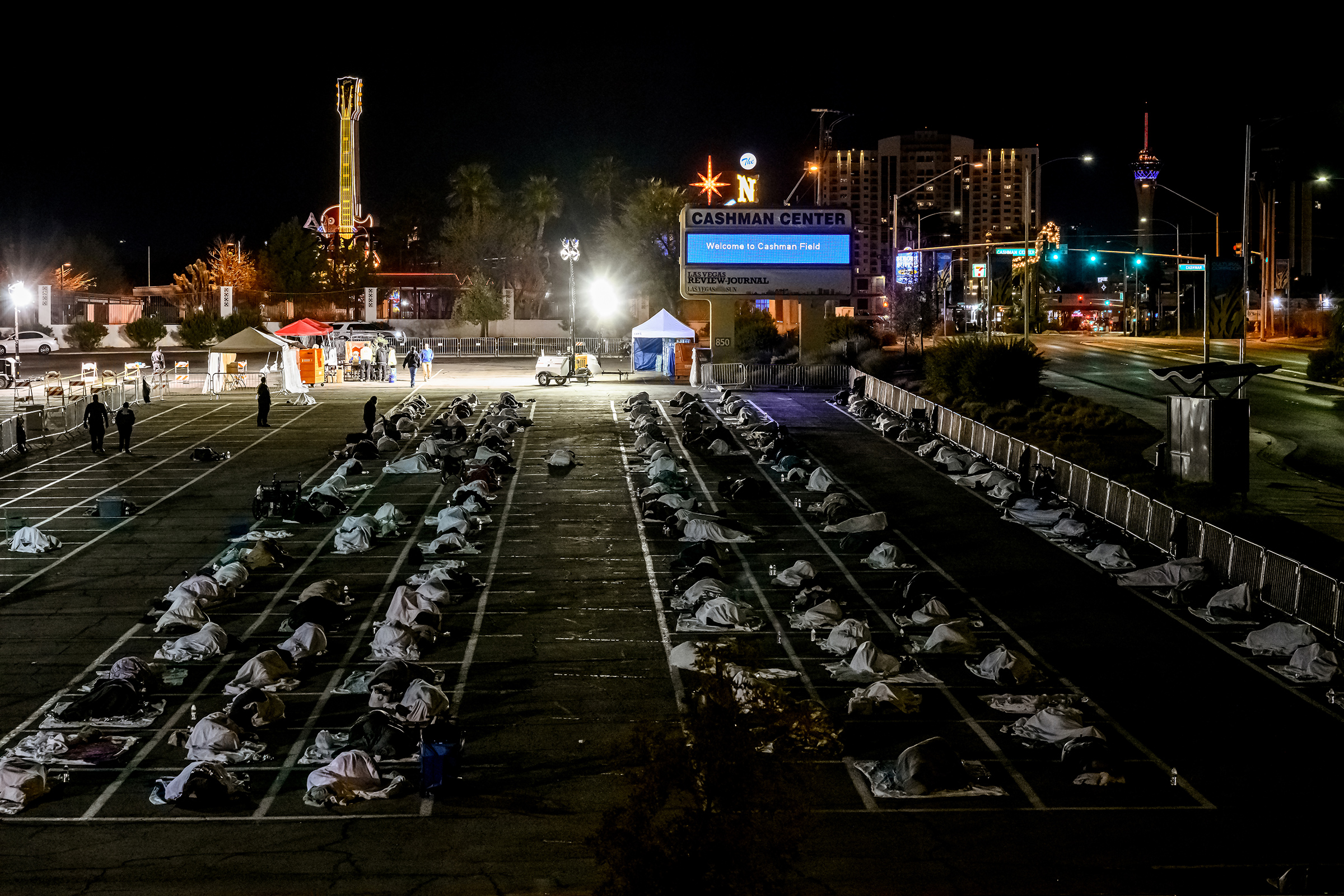 People sleeping in a parking lot in Las Vegas on March 30 after a homeless shelter shut down because of COVID-19