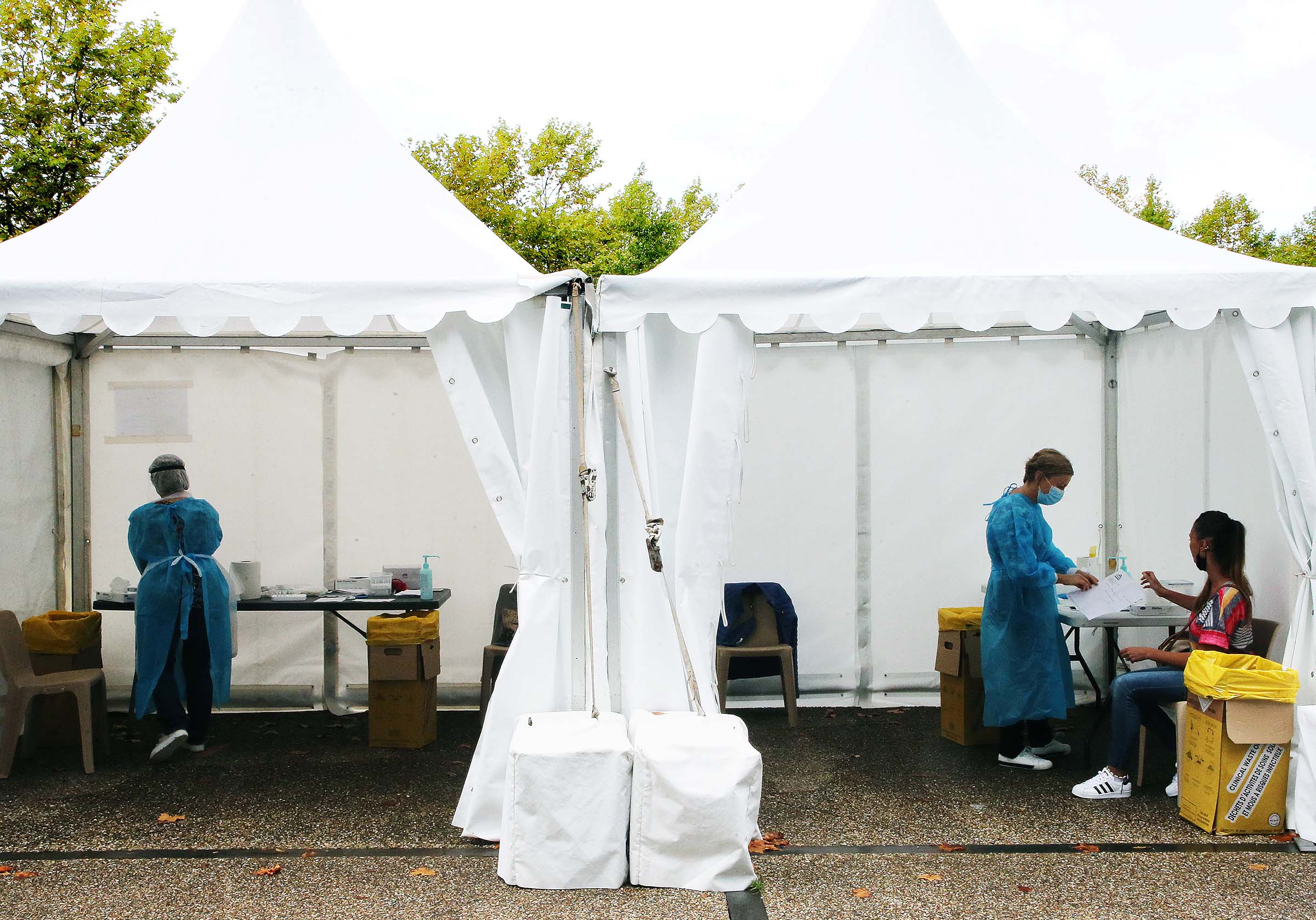 Technicians prepare to collect nasal swab samples for at a COVID-19 testing centre in Bayonne, France, on Sept. 22, 2020.