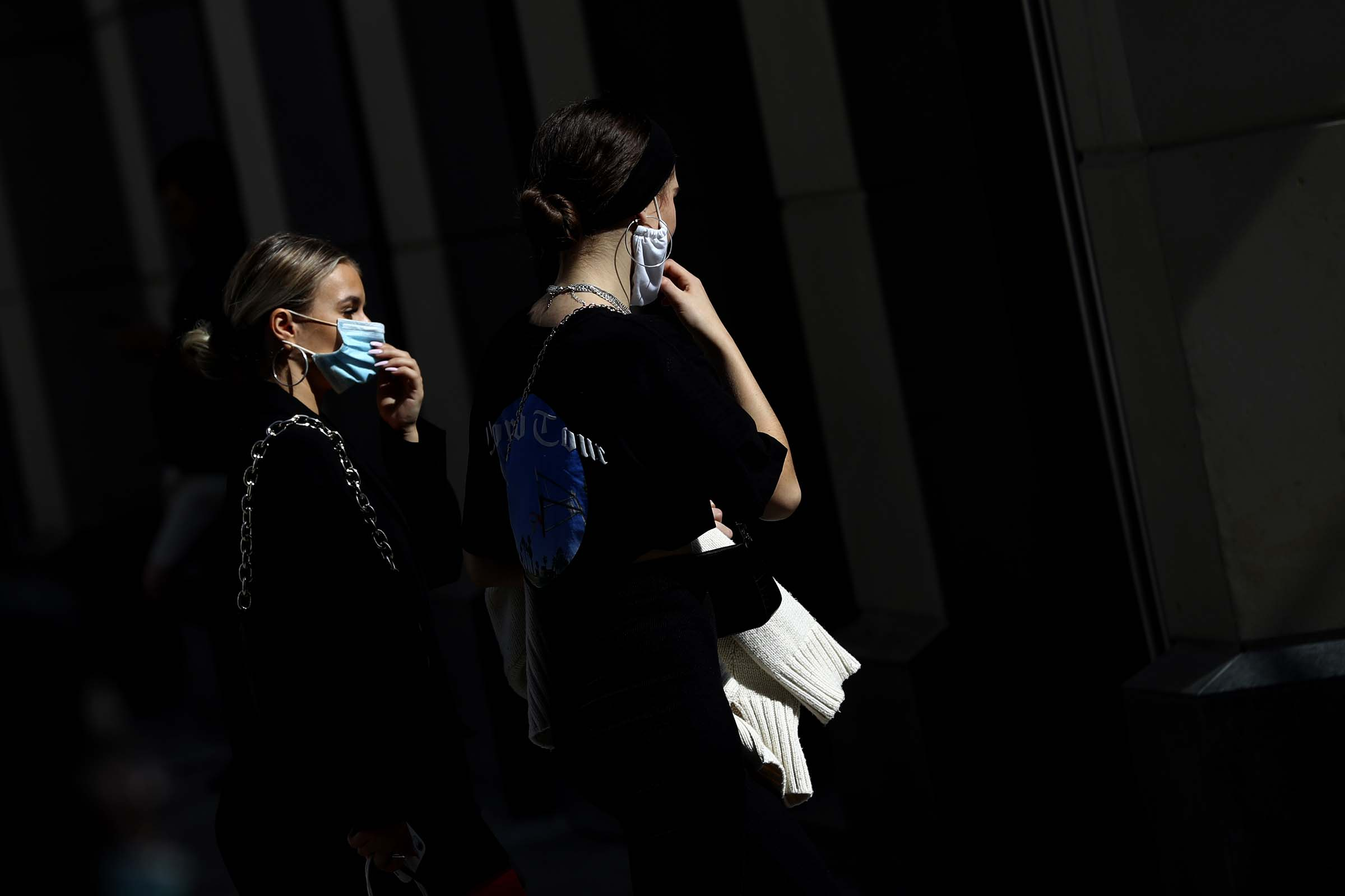 Young women wearing face masks as they walk trough downtown Munich, Germany on Sept. 22, 2020.