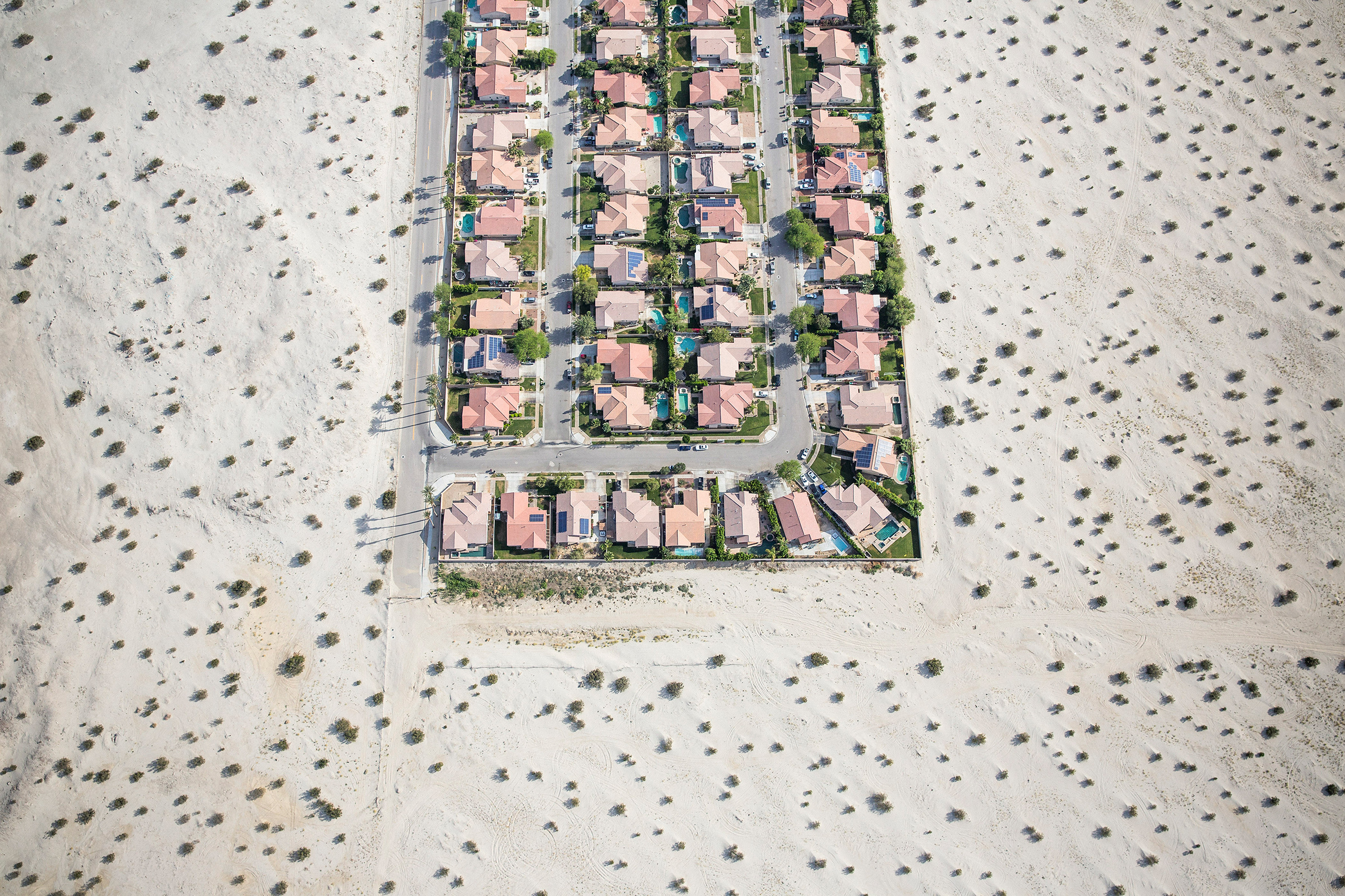 A housing development on the edge of undeveloped desert in Cathedral City, Calif., on April 3, 2015, during the state's punishing drought.