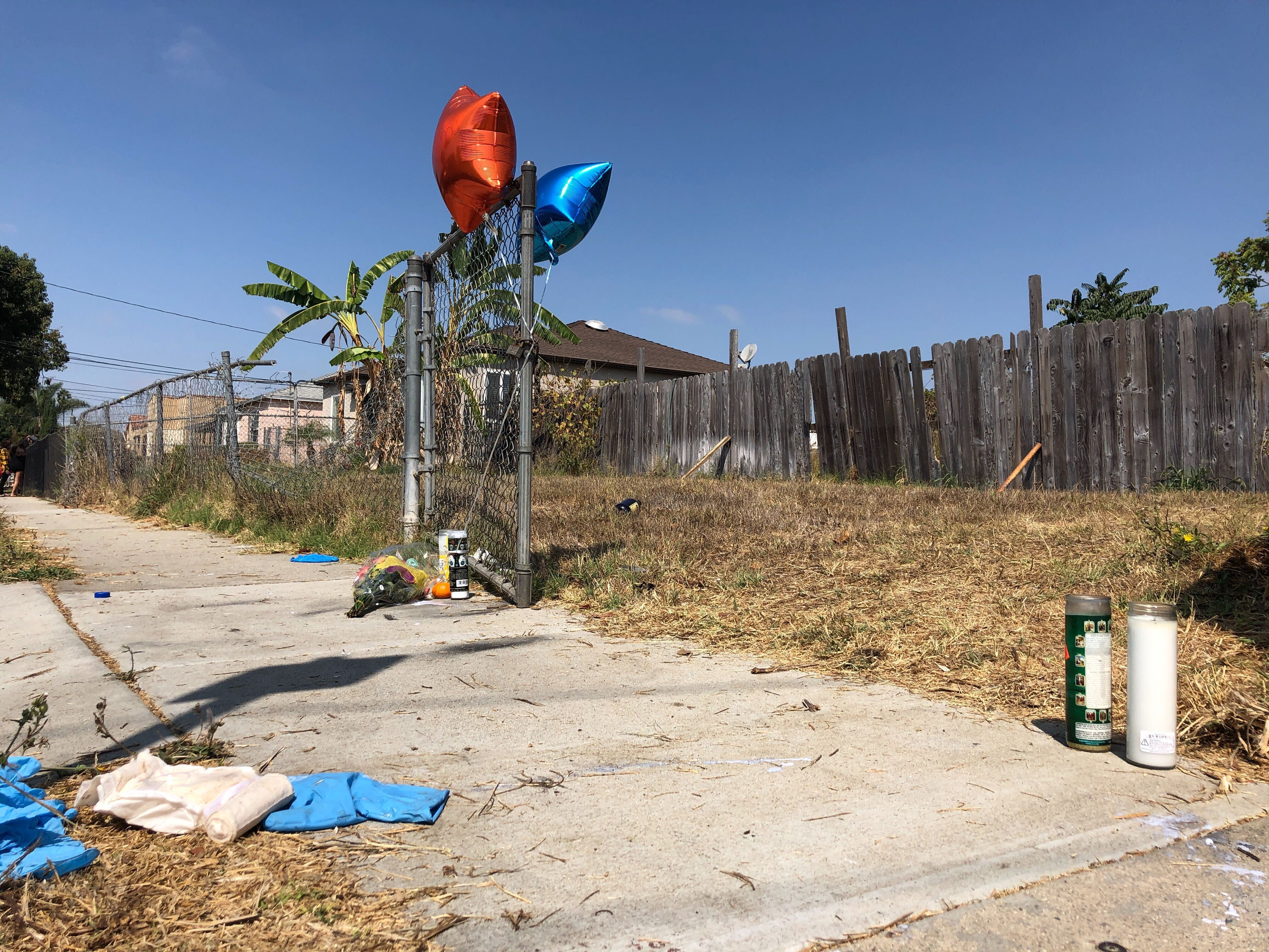 Balloons, candles and flowers are left on Sept. 1, 2020, as a memorial for Dijon Kizzee where he was fatally shot by Los Angeles Sheriff's deputies in the Westmont section of Los Angeles.